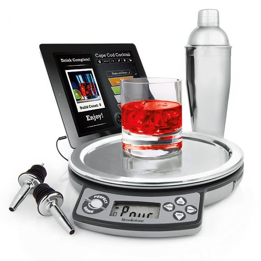 "The app-controlled Perfect Drink from Brookstone in 2014, is a bartending device that connects to your smartphone or tablet to give you step-by-step directions with a virtual ""glass"" that fills up as you pour."