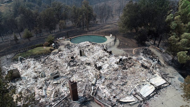 This home in the River Ridge Park subdivision in Redding Calif was completely destroyed in the Carr fire, Aug 1, 2018.