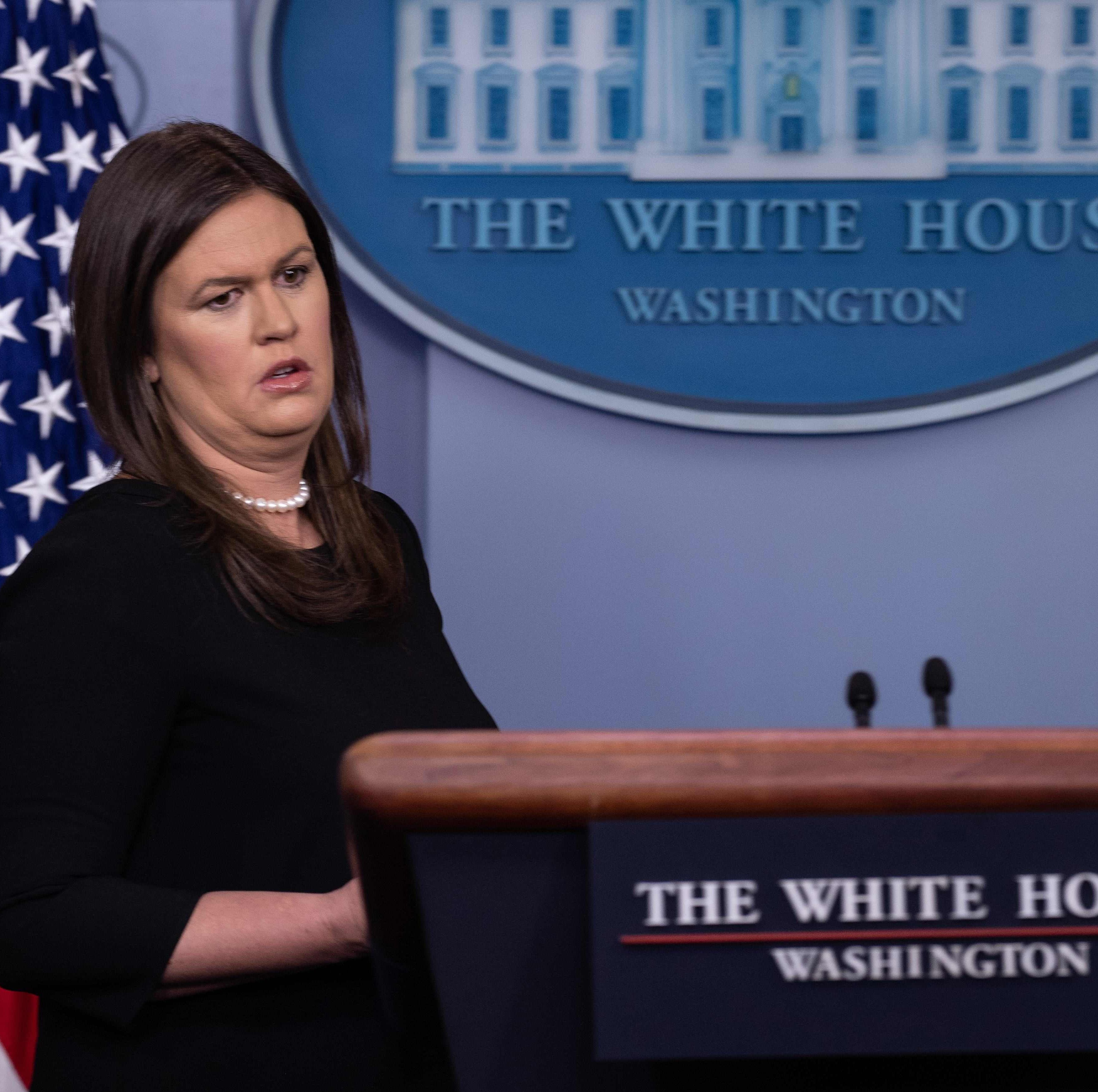 """White House Press Secretary Sarah Huckabee Sanders arrives for the press briefing at the White House in Washington, DC, on August 2, 2018. The US government on Thursday accused Russia of carrying out a """"pervasive"""" campaign to influence public opinion and elections, in a public warning just months before crucial legislative elections. """"We continue to see a pervasive messaging campaign from Russia to try and weaken and divide the United States,"""" said Dan Coats, the director of national intelligence. / AFP PHOTO / NICHOLAS KAMMNICHOLAS KAMM/AFP/Getty Images ORG XMIT: 330 ORIG FILE ID: AFP_1835CG"""