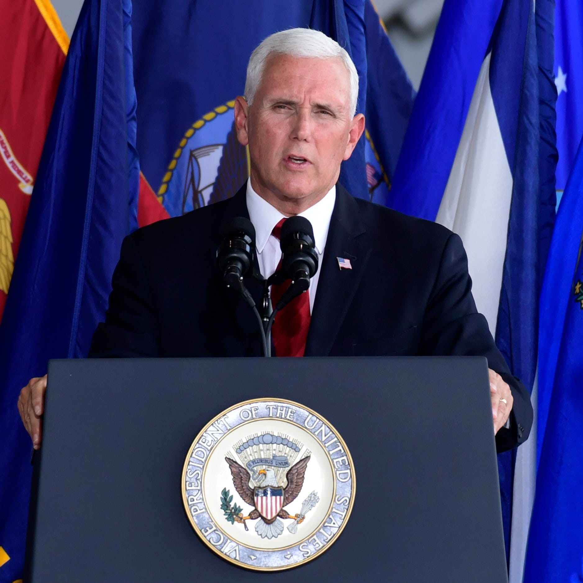 Vice President Mike Pence speaks at a ceremony marking the arrival of the remains believed to be of American service members who fell in the Korean War.