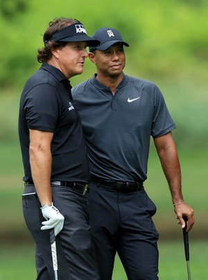 Phil Mickelson and Tiger Woods.