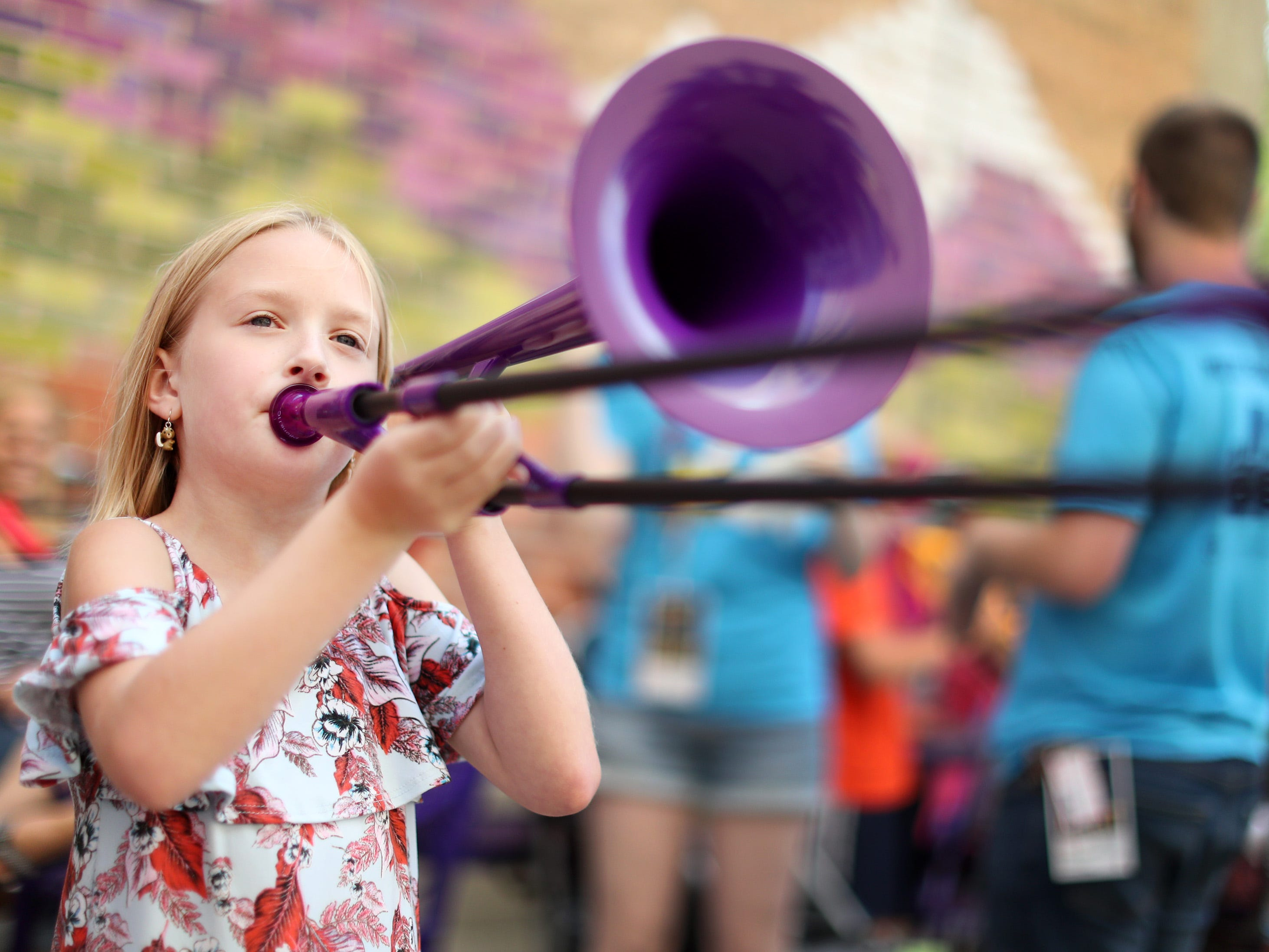 Danica Lafave, 9, plays a pBone at the pBone Jam music education event at The Parklet at 222 Building during the second day of Mile of Music Friday, Aug. 2, 2018, in Appleton, Wis.