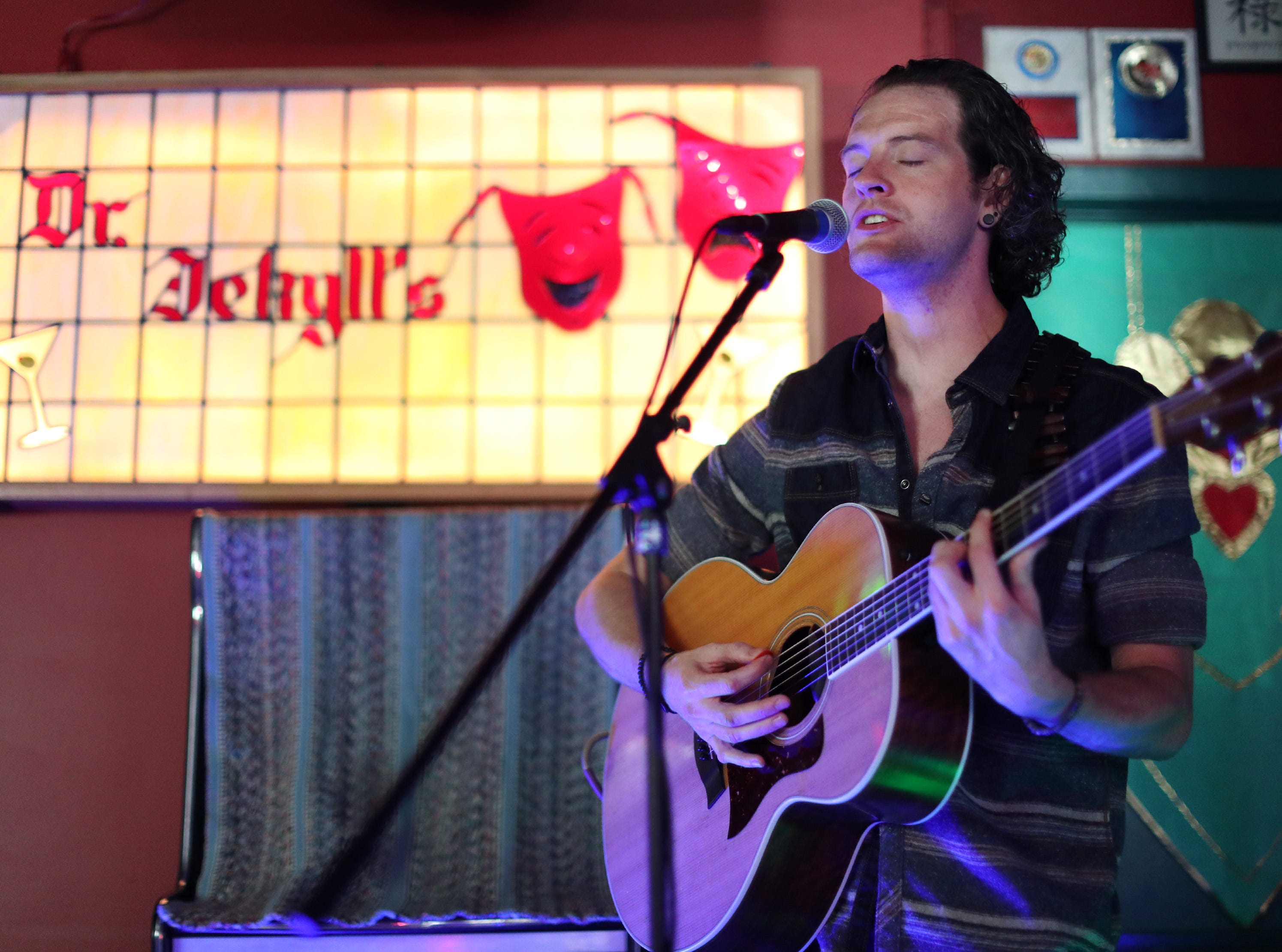 Ryan M. Brewer performs at Dr. Jekyll's during the second day of Mile of Music Friday, Aug. 2, 2018, in Appleton, Wis.