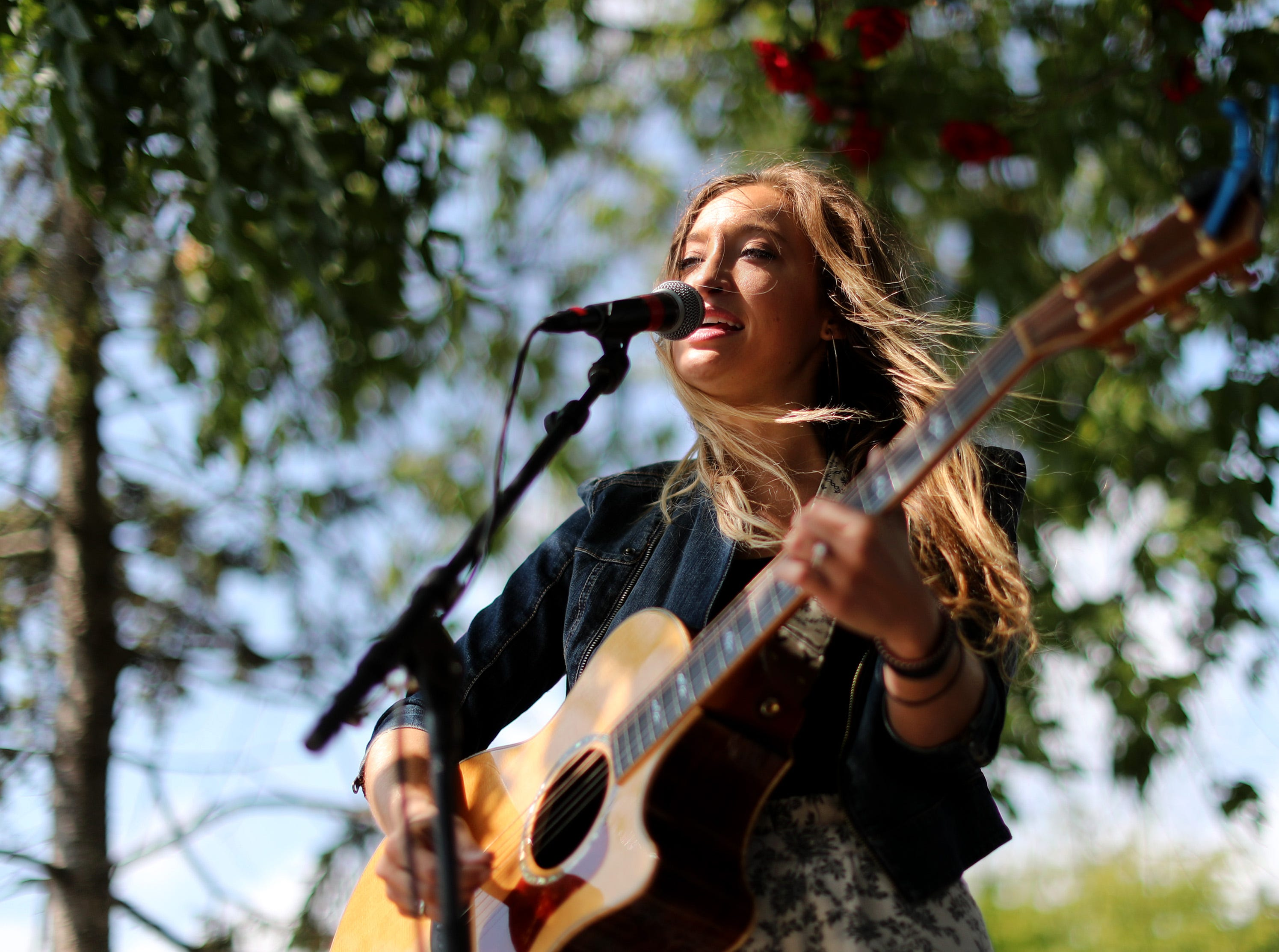 Maybe April performs at the Fox River House during the second day of Mile of Music Friday, Aug. 2, 2018, in Appleton, Wis.