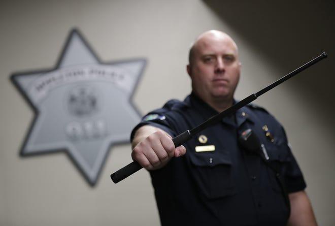 Lt. Bill Krieg, defense tactics coordinator at the Appleton Police Department, displays an expandable baton Wednesday in Appleton.