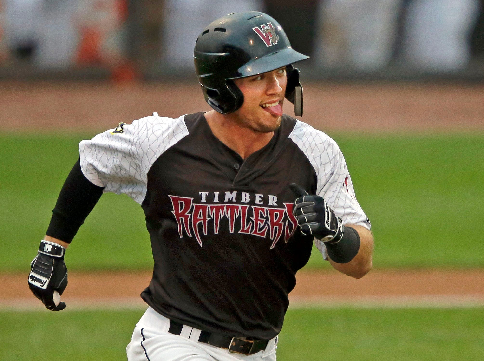 Tristen Lutz of the Wisconsin Timber Rattlers knows he's out against the Burlington Bees Thursday, August 2, 2018, at Neuroscience Group Field at Fox Cities Stadium in Grand Chute, Wis.Ron Page/USA TODAY NETWORK-Wisconsin