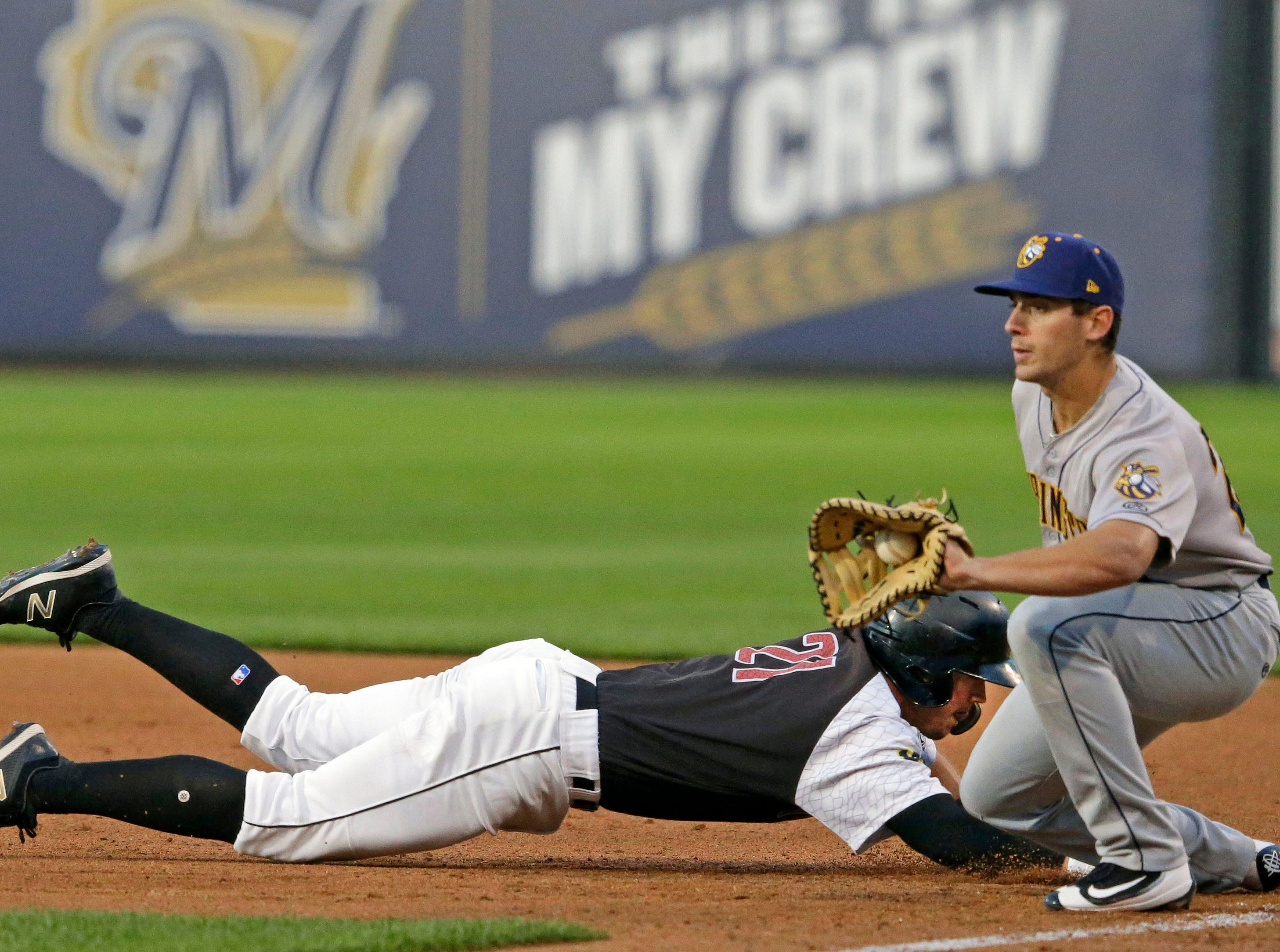Tristen Lutz of the Wisconsin Timber Rattlers dives back to first against the Burlington Bees Thursday, August 2, 2018, at Neuroscience Group Field at Fox Cities Stadium in Grand Chute, Wis.Ron Page/USA TODAY NETWORK-Wisconsin