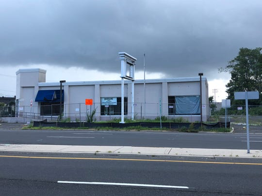 A fence has gone up around the former Ethan Allen furniture store on Route 35 in Eatontown. It will way for QuickChek.