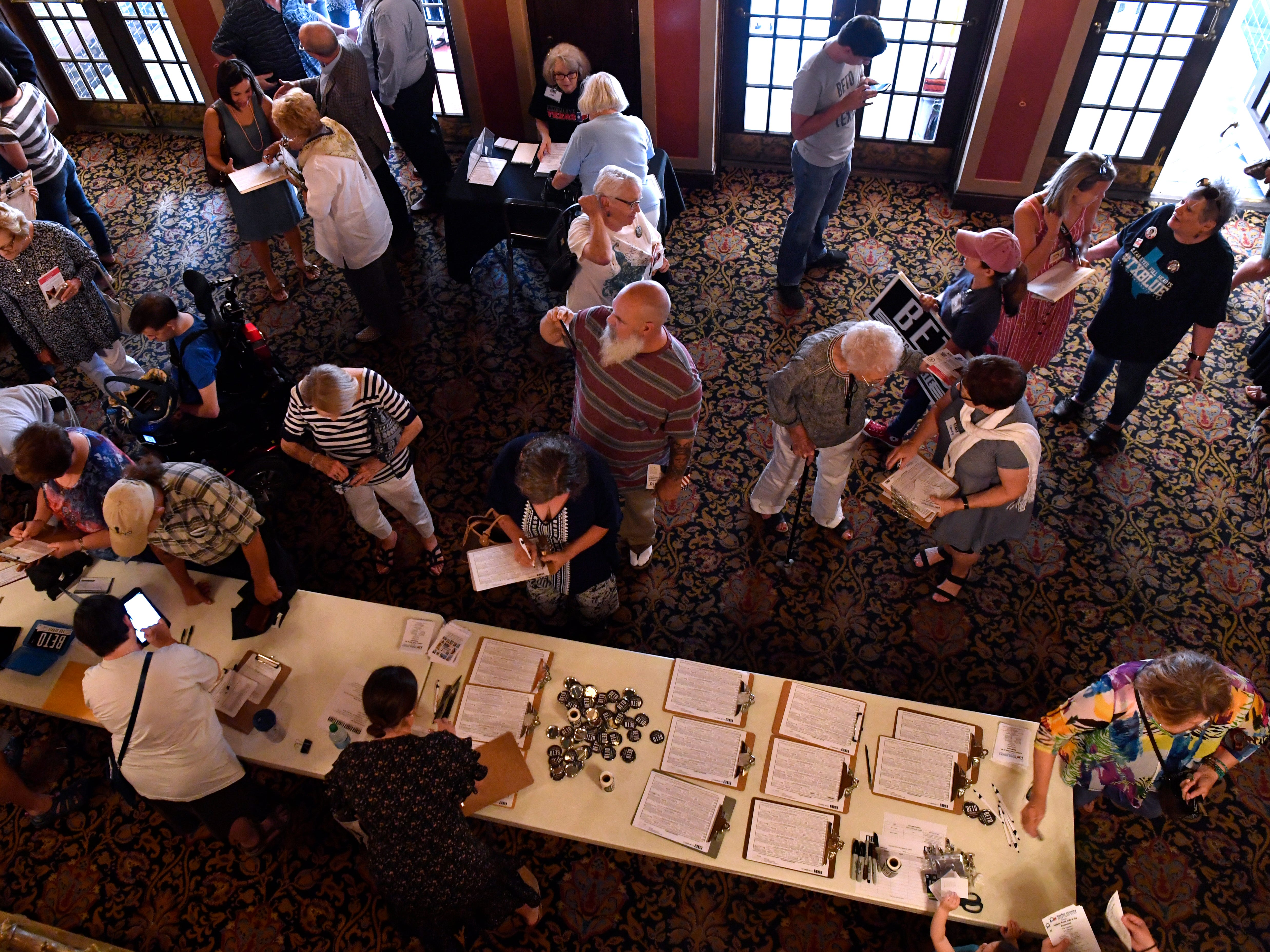 Attendees and campaign workers mingle in the lobby of the Paramount Theatre Thursday August 2, 2018. Five Democratic candidates spoke to a crowd of nearly 800 people during a town hall meeting which included U.S. Senate hopeful Beto O'Rourke.
