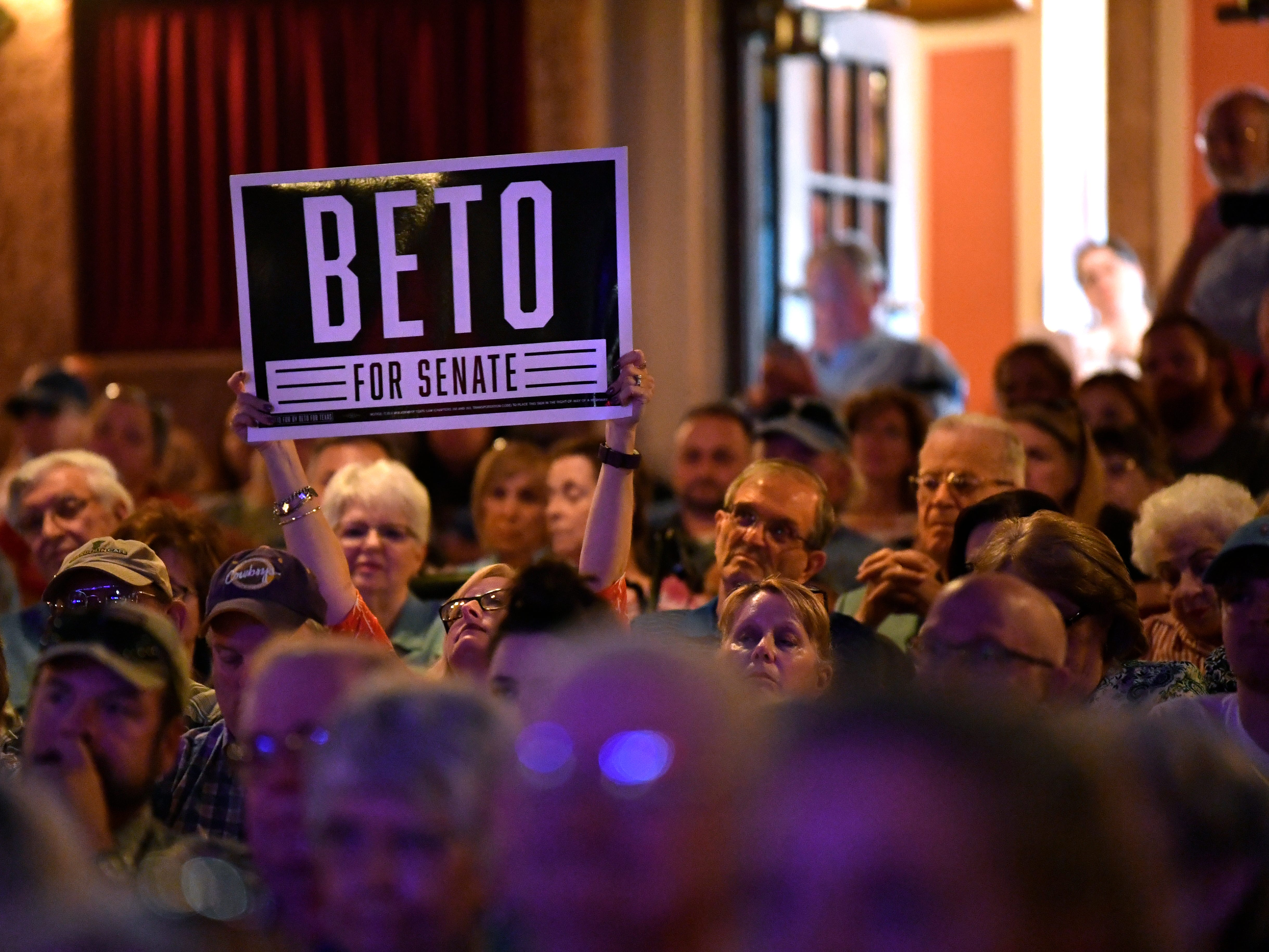 An audience member holds up a sign supporting U.S. Senate candidate Beto O'Rourke Thursday August 2, 2018 at the Paramount Theatre. O'Rourke's bid to unseat Republican Ted Cruz is one of the most closely-watched races in the country, he and four other Democratic candidates spoke to a crowd of nearly 800 people.
