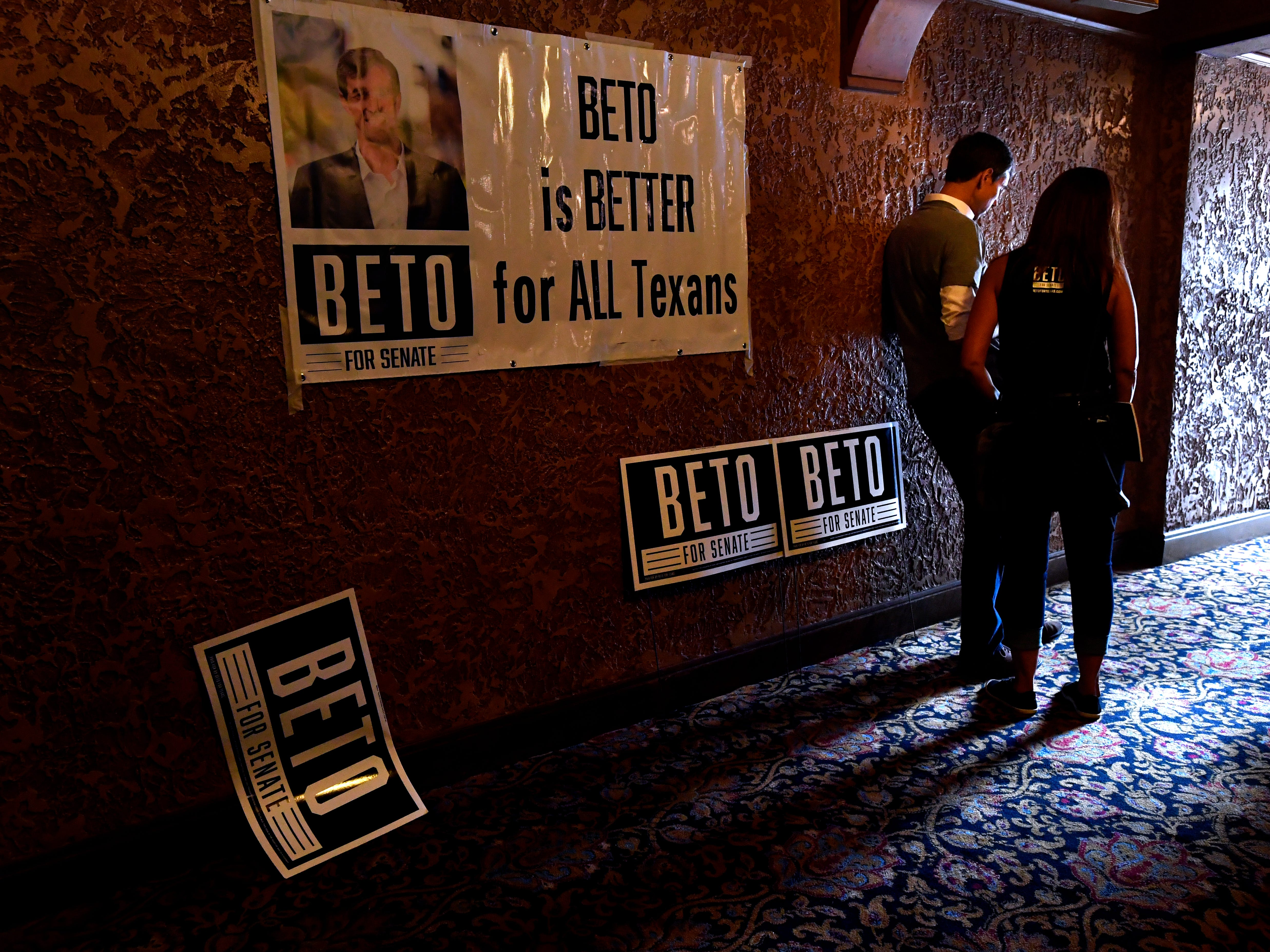 U.S. Senate candidate Beto O'Rourke reads a message on his phone with a member of his campaign staff after completing the photo line at a town hall meeting in the Paramount Theatre Thursday August 2, 2018. Four other Democratic candidates running for state office joined him during the event, speaking to a crowd of nearly 800 people.