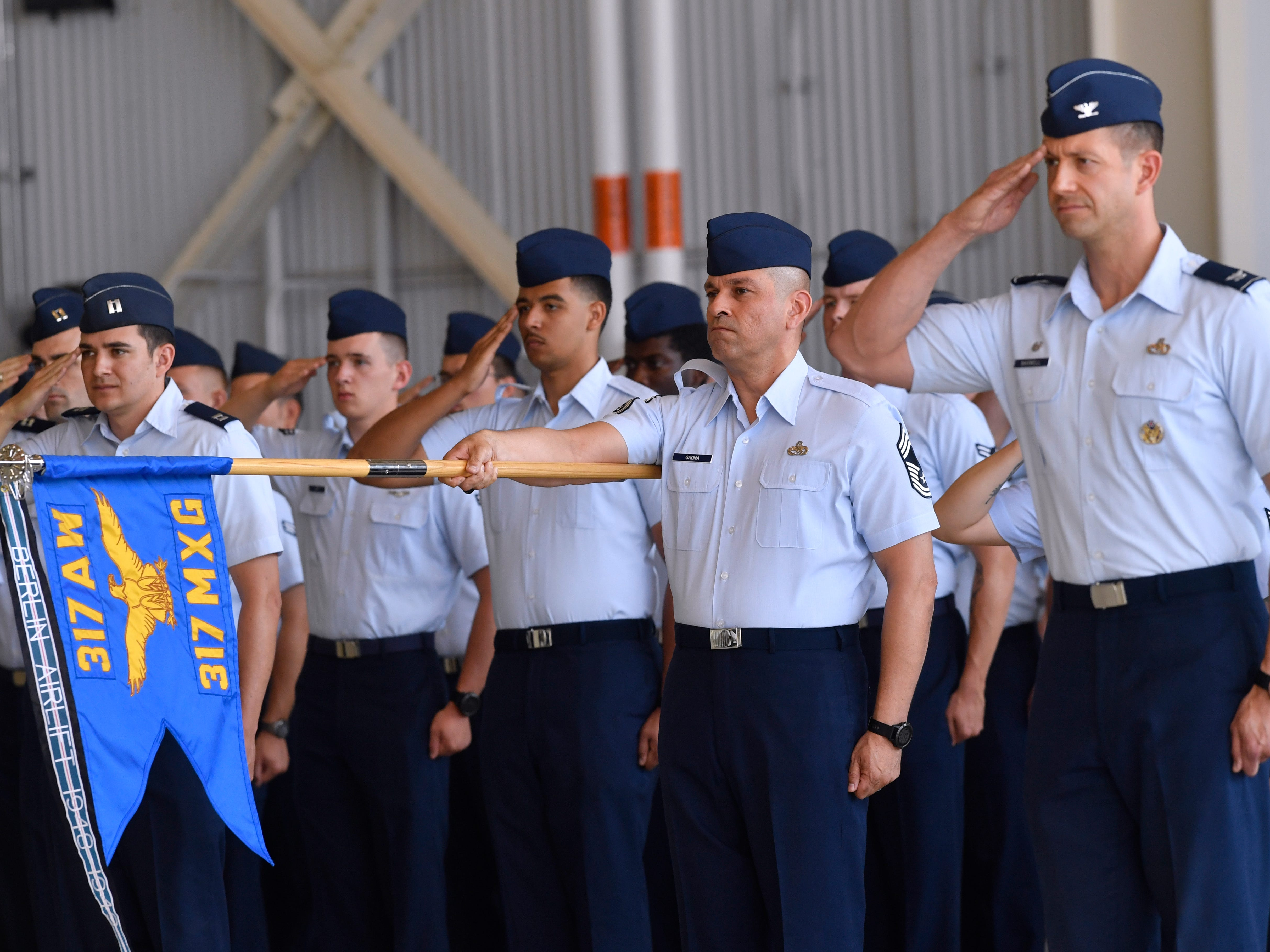 Members of the 317th Airlift Wing salute in formation during the unit's assumption of command ceremony Friday August 3, 2018 at Dyess Air Force Base. Col. Jeffrey Menasco was given command of the wing by Major Gen. Sam Barrett, Commander of the 18th Air Force.