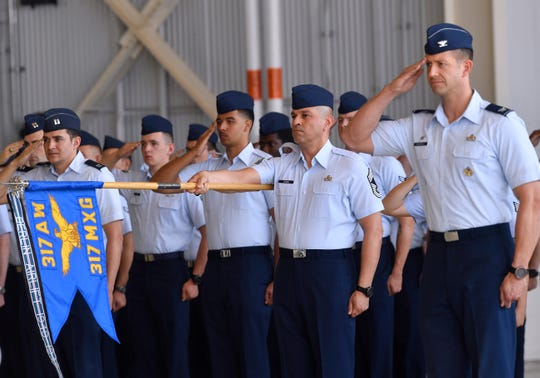 Members of the 317th Airlift Wing salute in formation during the unit's change of command ceremony Friday at Dyess Air Force Base. Col. Jeffrey Menasco was given command of the wing by Maj. Gen. Sam Barrett, commander of the 18th Air Force.