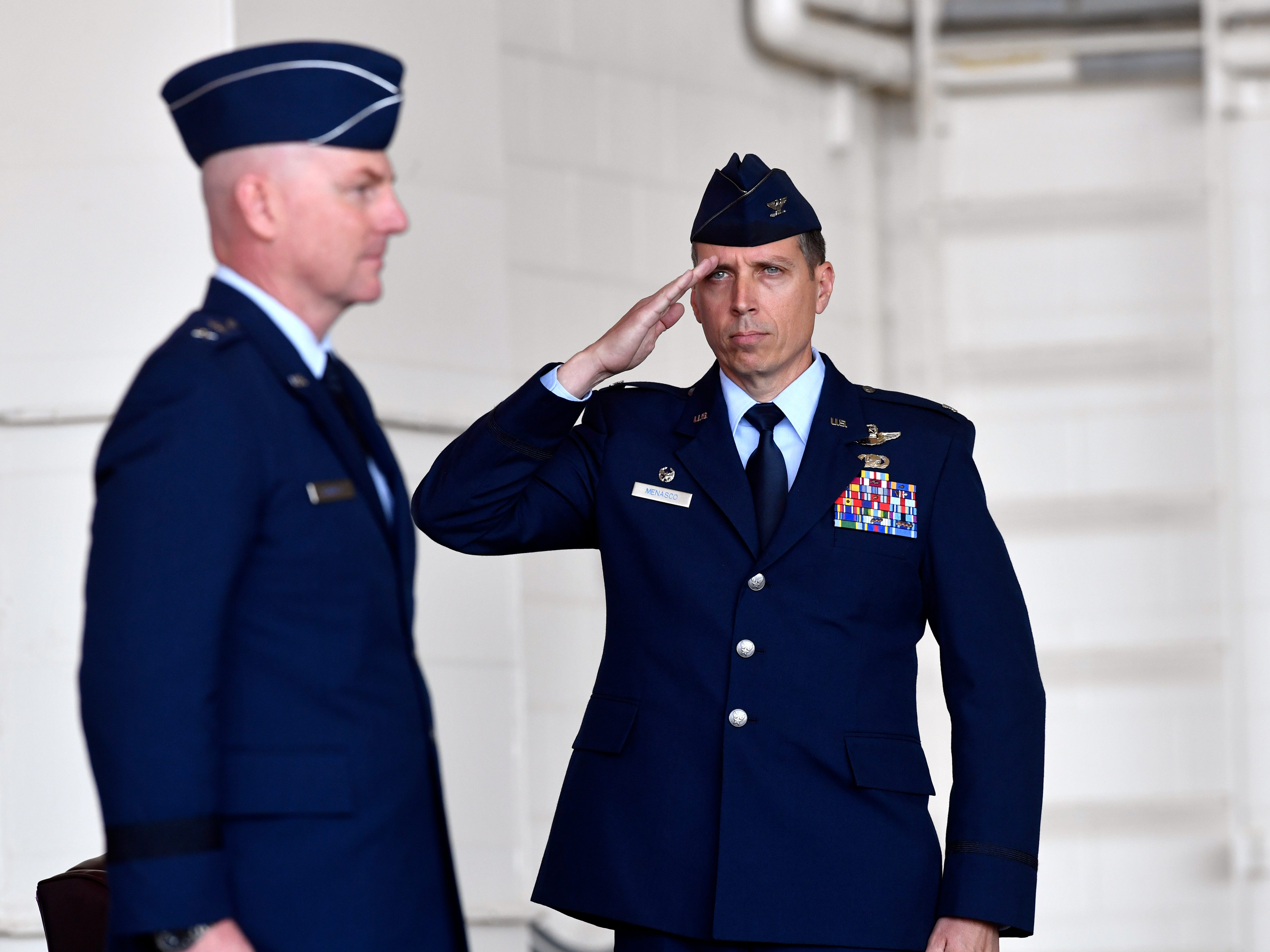 Col. Jeffrey Menasco salutes Major Gen. Sam Barrett, Commander of the 18th Air Force, during an assumption of command ceremony for the 317th Airlift Wing Friday August 3, 2018 at Dyess Air Force Base. Menasco was named the 317th's new commander during the proceedings.