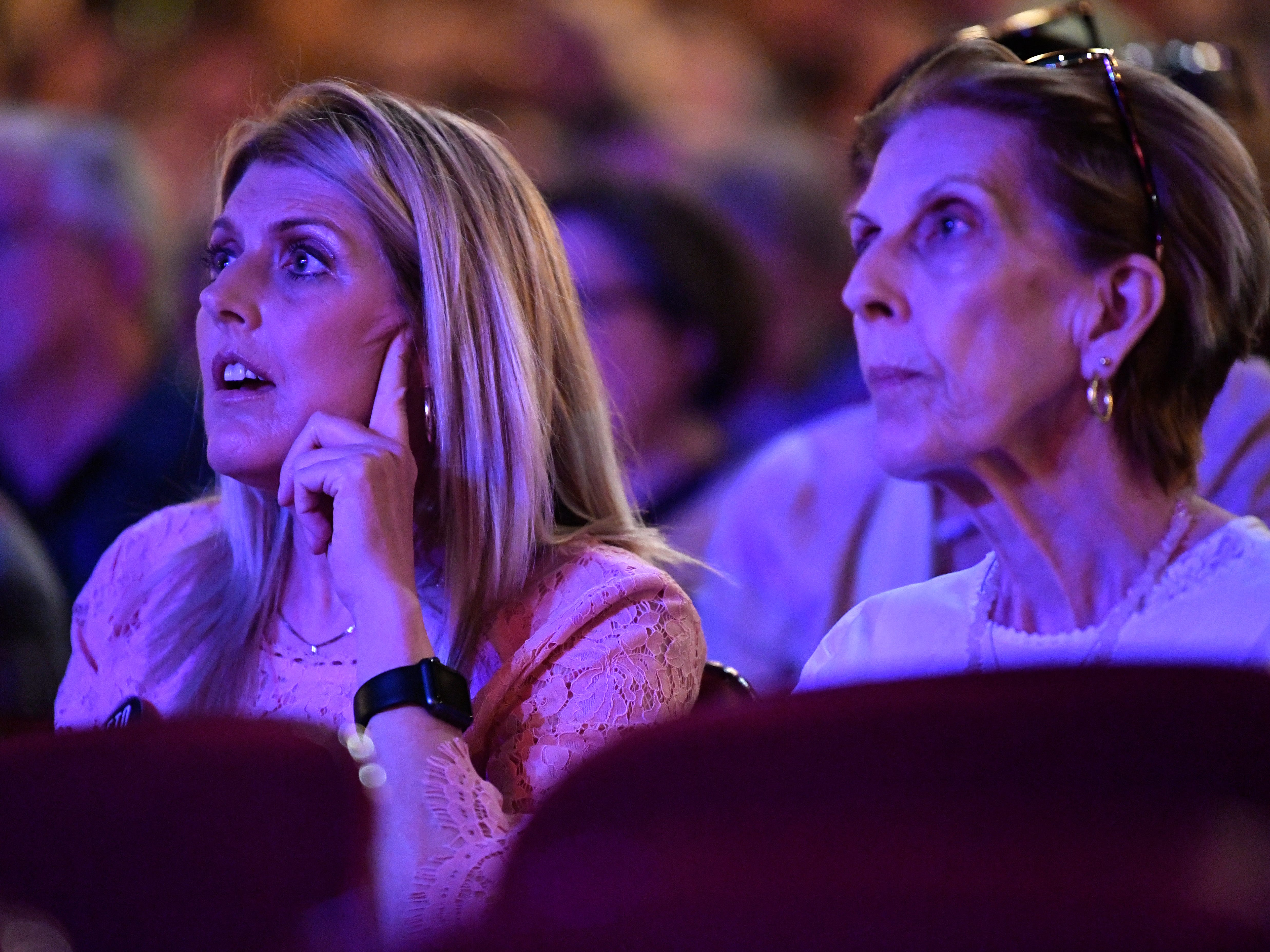 Billie Duggan (left) listens with her mother Reta Morrison to U.S. Senate candidate Beto O'Rourke during a town hall meeting at the Paramount Theatre Thursday August 2, 2018. O'Rourke, who hopes to unseat Republican Ted Cruz, was joined by four other Democratic candidates for state office.
