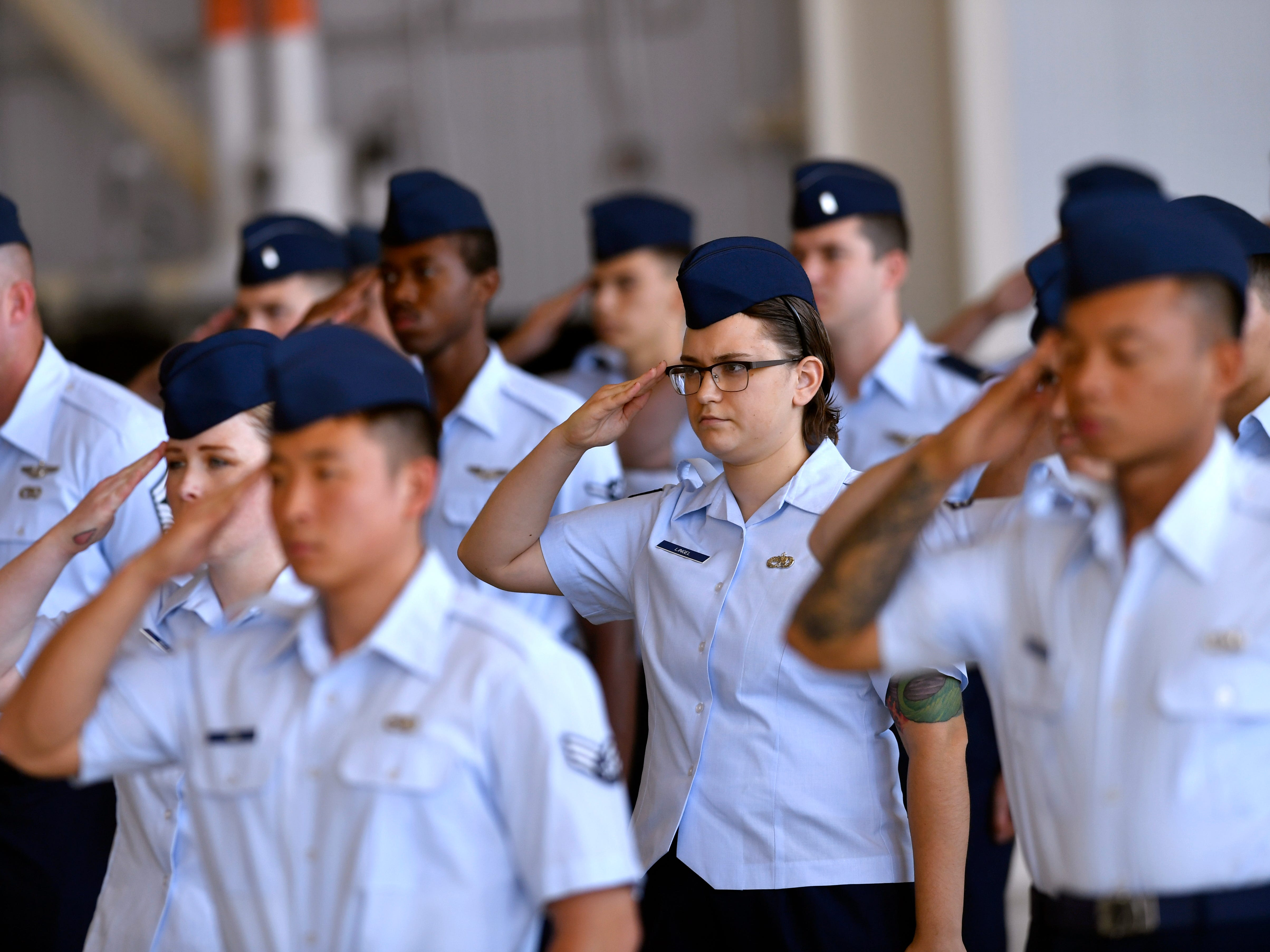 Members of the 317th Airlift Wing salute their new commander for the first time during the unit's assumption of command Friday August 3, 2018 at Dyess Air Force Base.  Col. Jeffrey Menasco was given command of the wing by Major Gen. Sam Barrett, Commander of the 18th Air Force.