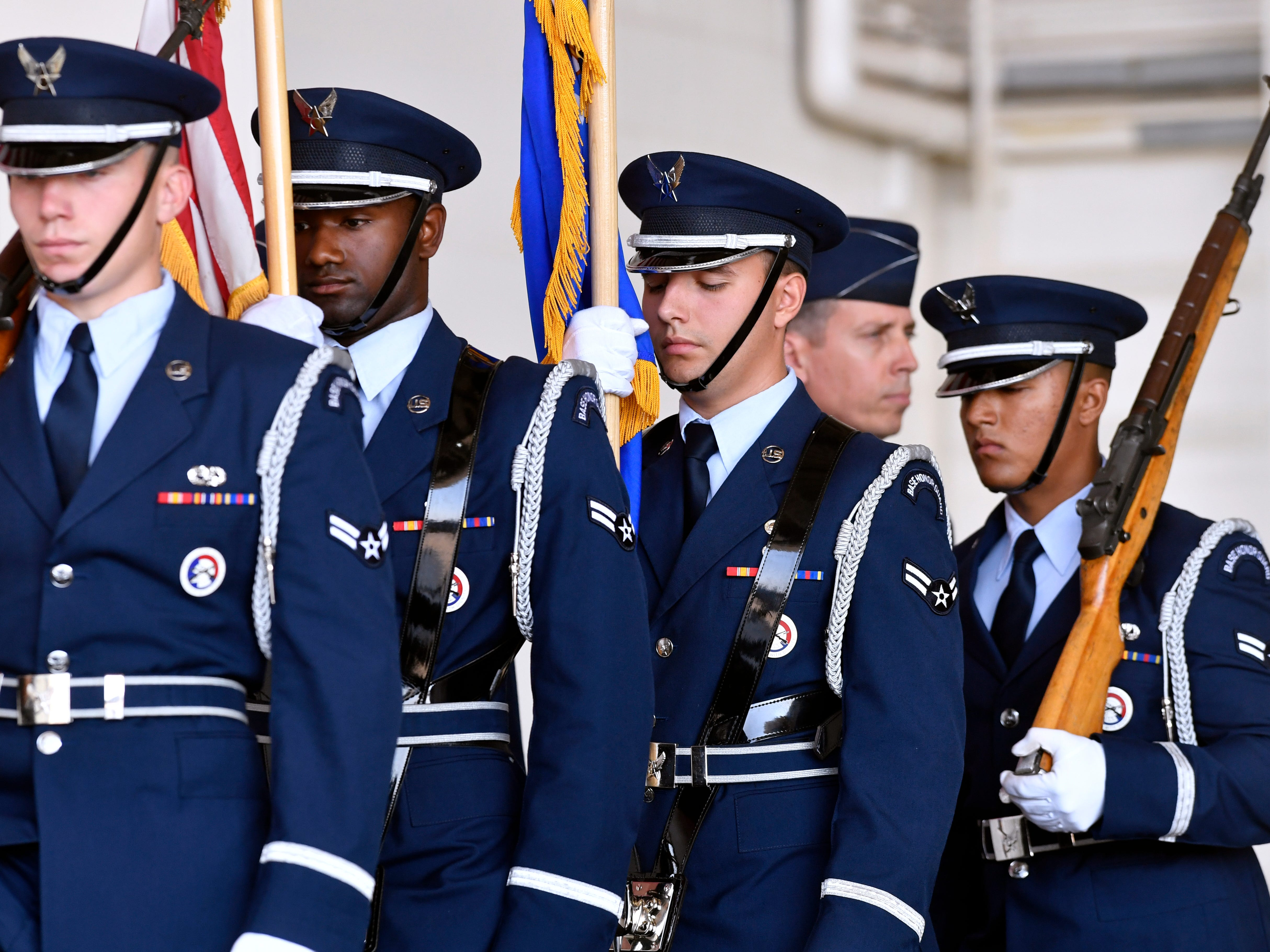 Members of the Dyess Air Force Base Honor Guard march past Col. Jeffrey Mensaco during the assumption of command ceremony for the 317th Airlift Wing Friday August 3, 2018. Menasco was named the wing's new commander during the proceedings.