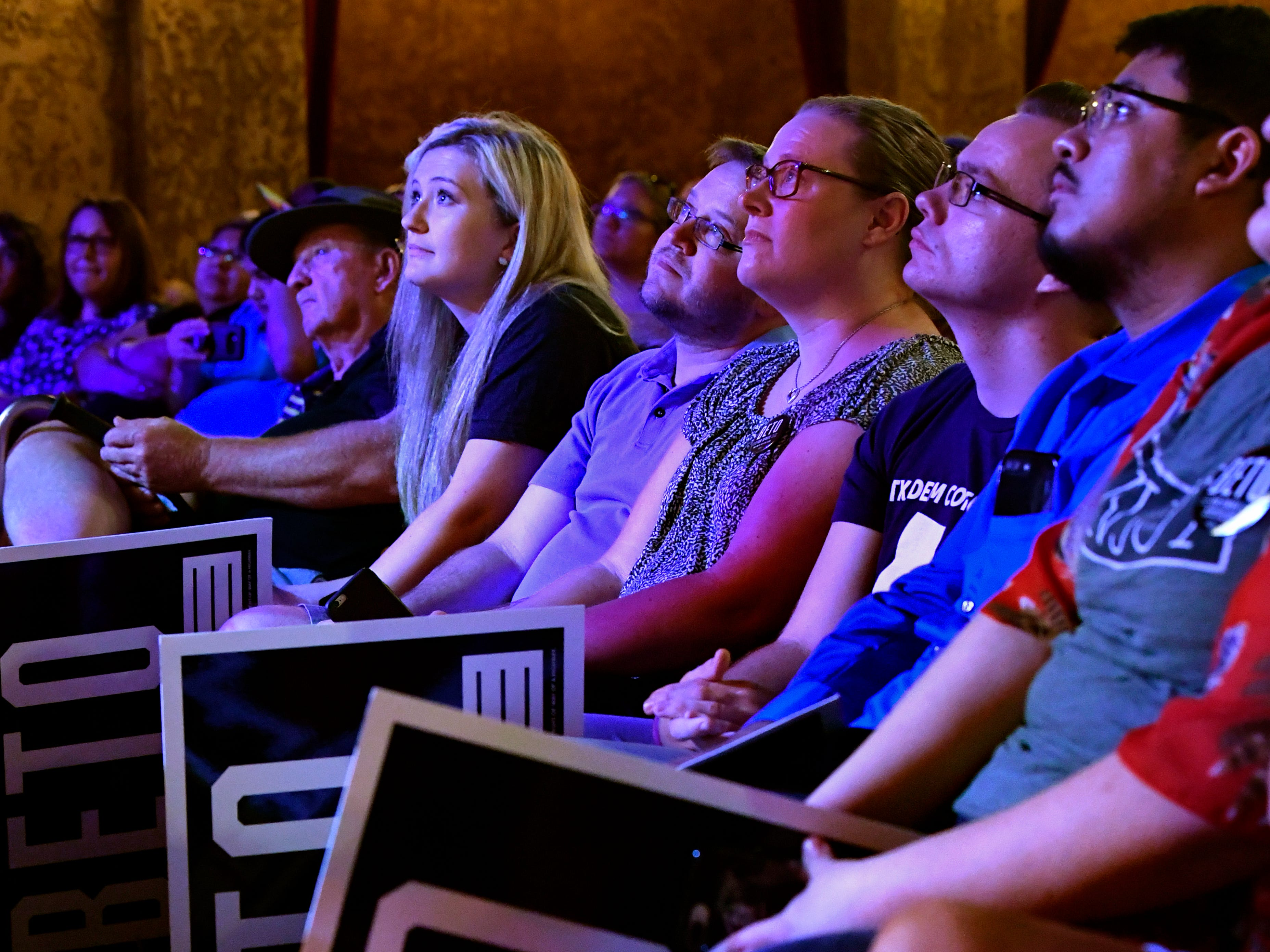 Beto O'Rourke fans watch their candidate speak during a town hall meeting at the Paramount Theatre August 2, 2018. Five Democrats, including O'Rourke who hopes to unseat Republican Senator Ted Cruz, spoke to a crowd of nearly 800 people.