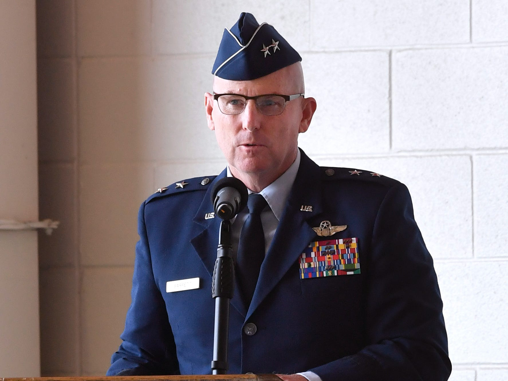 Major Gen. Sam Barrett, Commander of the 18th Air Force, makes his remarks during the 317th Airlift Wing assumption of command Friday August 3, 2018 at Dyess Air Force Base. Col. Jeffrey Menasco was given command of the wing by Barrett during the ceremony.