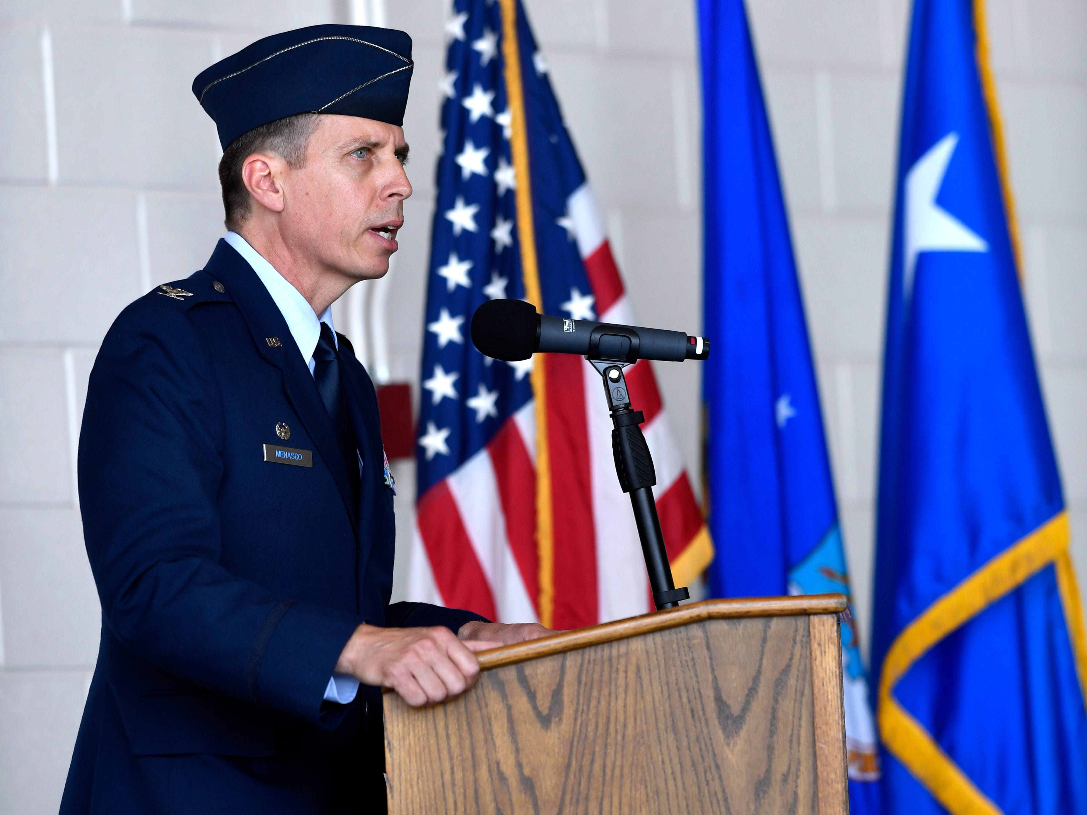 Col. Jeffrey Menasco makes his remarks after assuming command of the 317th Airlift Wing during an assumption of command ceremony at Dyess Air Force Base Friday August 3, 2018.