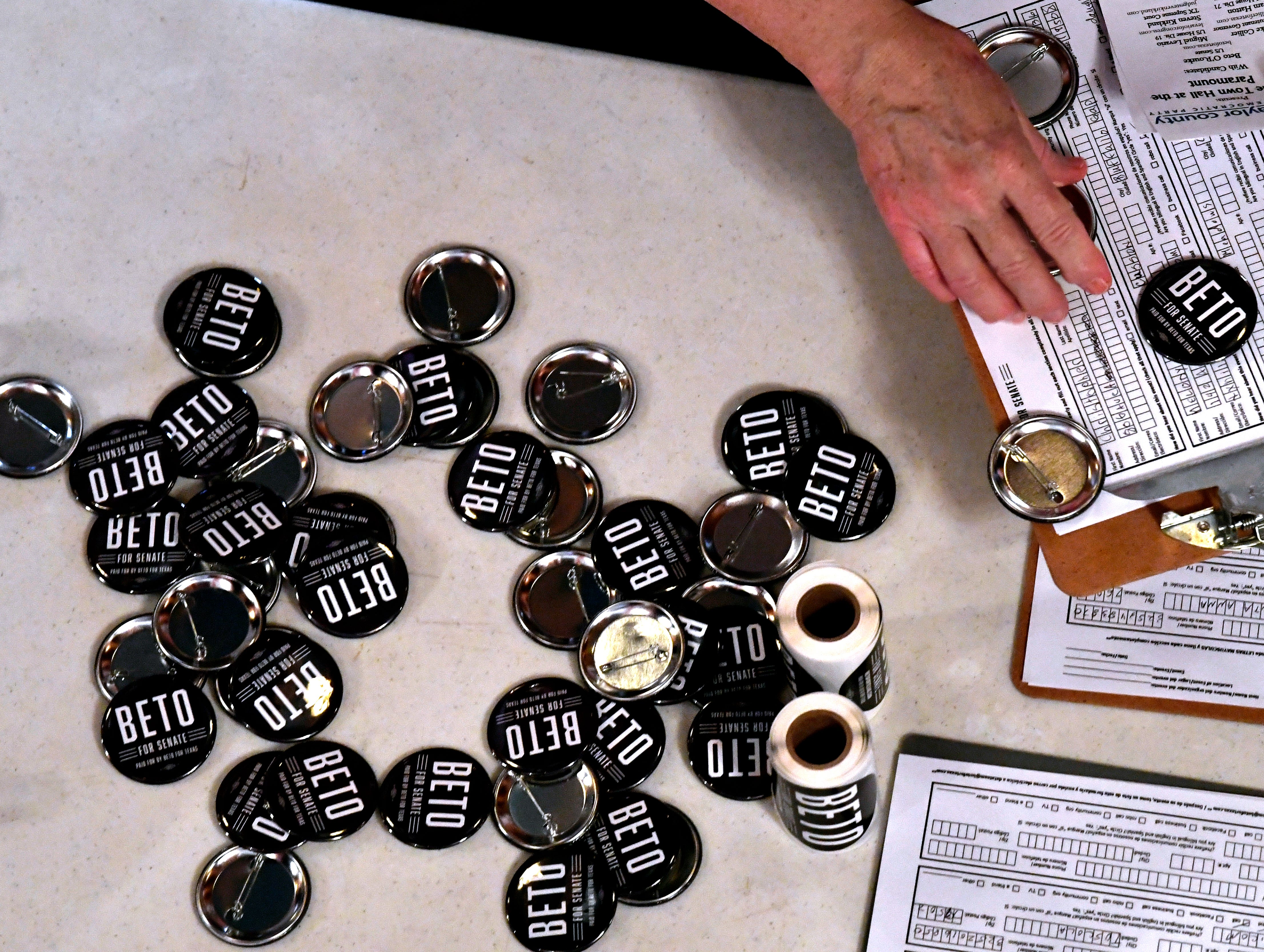 Beto O'Rourke campaign buttons sit in a dwindling pile on a table in the lobby of the Paramount Theatre Thursday August. 2, 2018. Five Democratic candidates spoke to a crowd of nearly 800 people during a town hall meeting which included U.S. Senate hopeful Beto O'Rourke.