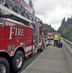 Emergency responders on the Lund Avenue Bridge in Port Orchard on Friday.