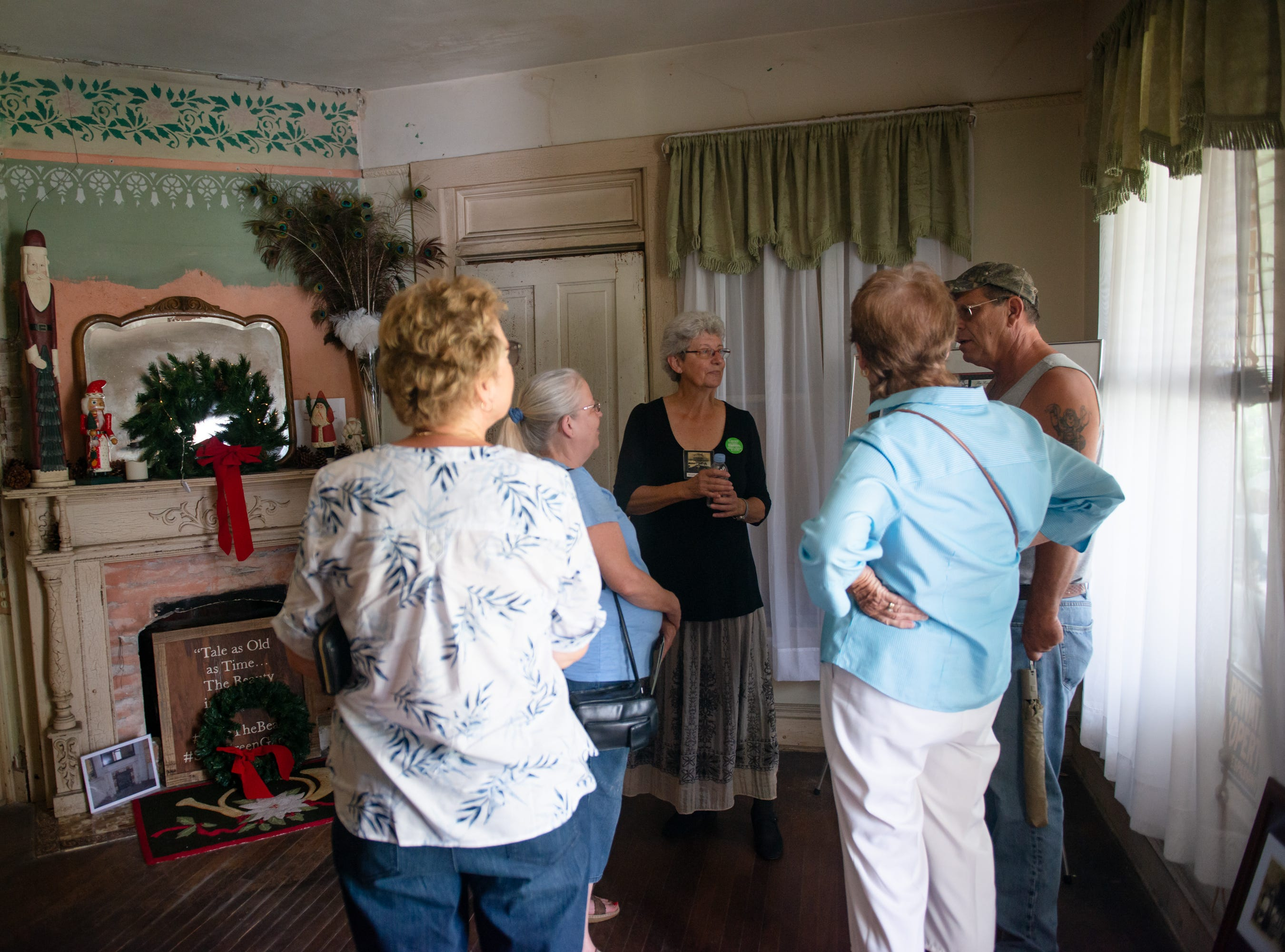 Visitors take a tour at the Christmas in July event, which raised money to restore the Green Gables Victorian house in Melbourne.