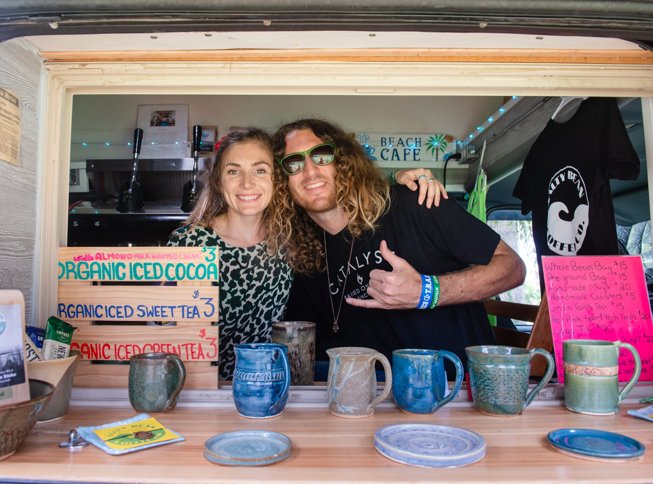 Paige Mills and Noah Martin, owners of the Salty Bean Coffee Co., at the Christmas in July event, which raised money to restore the Green Gables Victorian house in Melbourne.