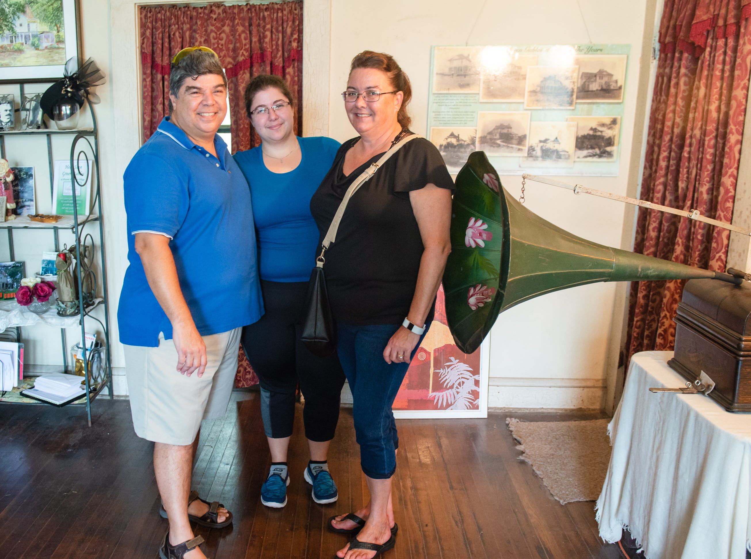 Gil, Megan and Rebecca Castillo at the Christmas in July event, which raised money to restore the Green Gables Victorian house in Melbourne.