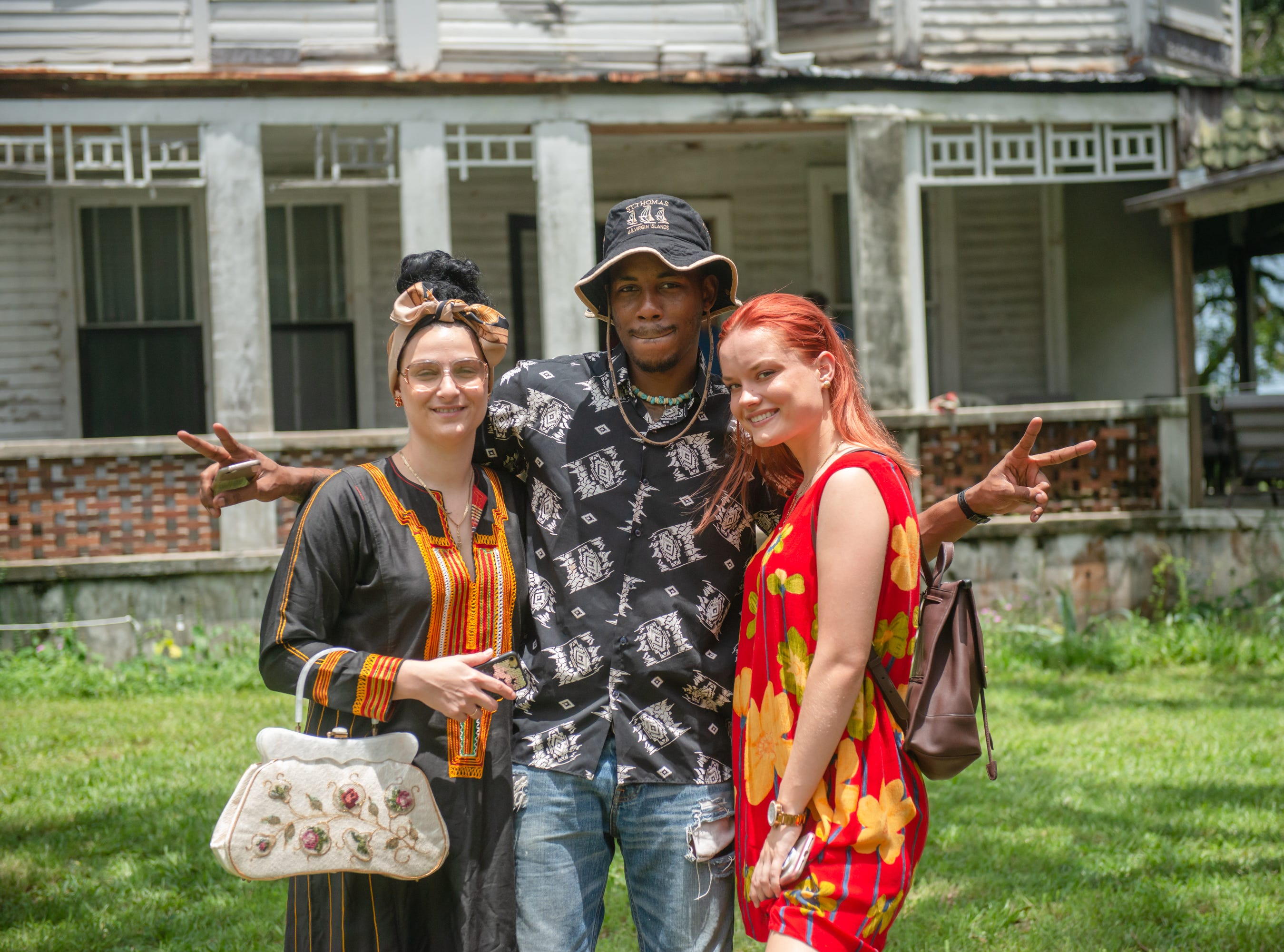 Nicole Herrera, Marcos Davis and Alissa Herrera at the Christmas in July event, which raised money to restore the Green Gables Victorian house in Melbourne.