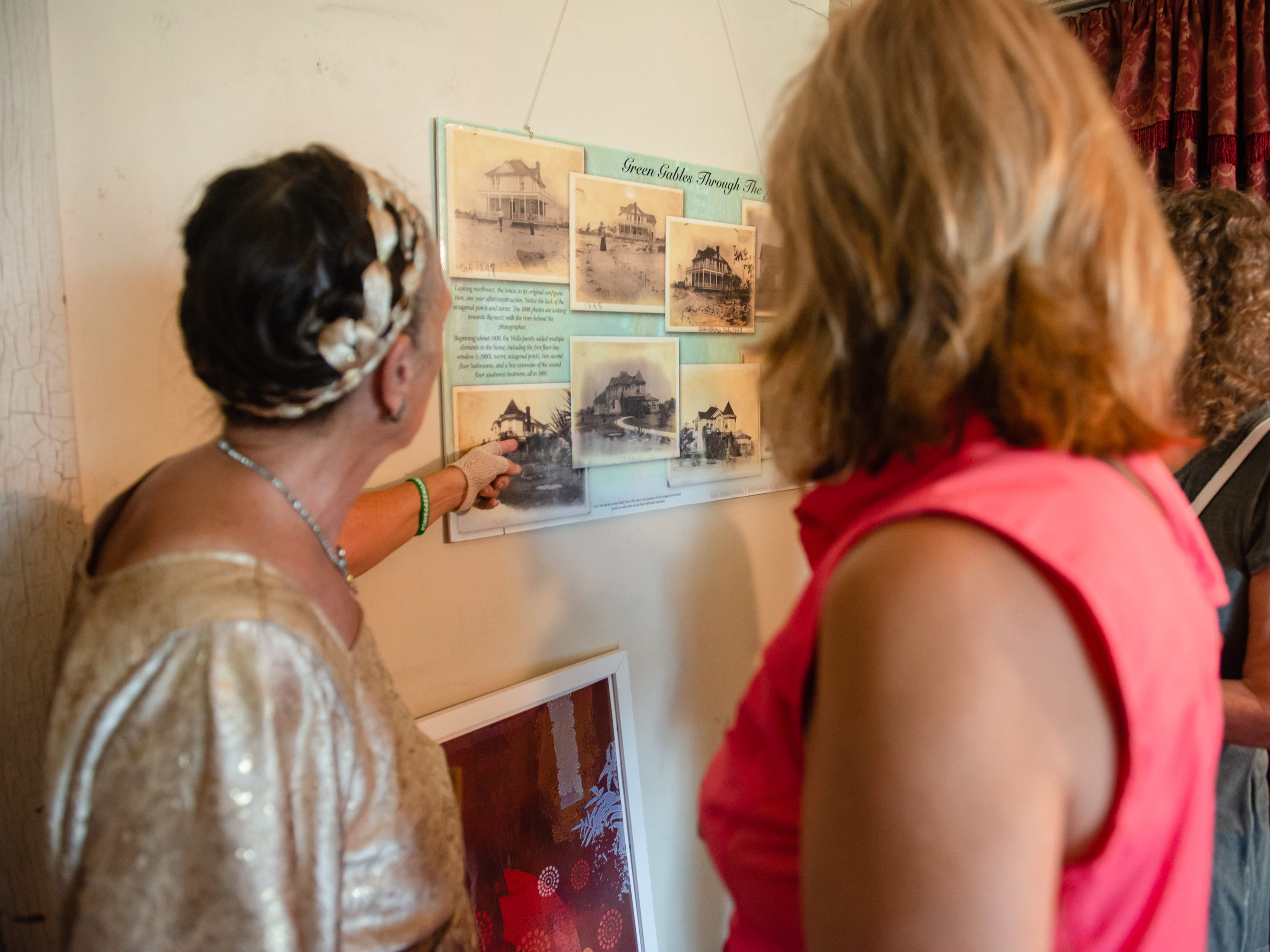 Docent Rita Curry Porter explains the history of the home at the Christmas in July event, which raised money to restore the Green Gables Victorian house in Melbourne.