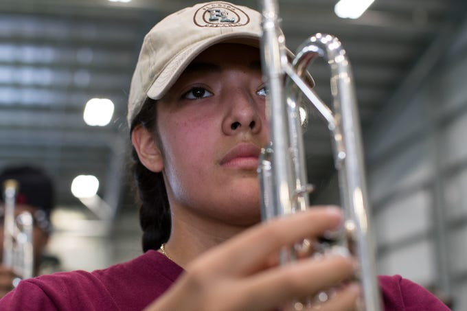 The Calallen marching band members do marching drills during practice on their indoor field at Callallen High School on Tuesday, July 31, 2018.
