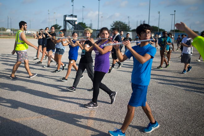 Members of Carroll's band practices in the parking lot of Carroll High School onMonday, July 30, 2018.
