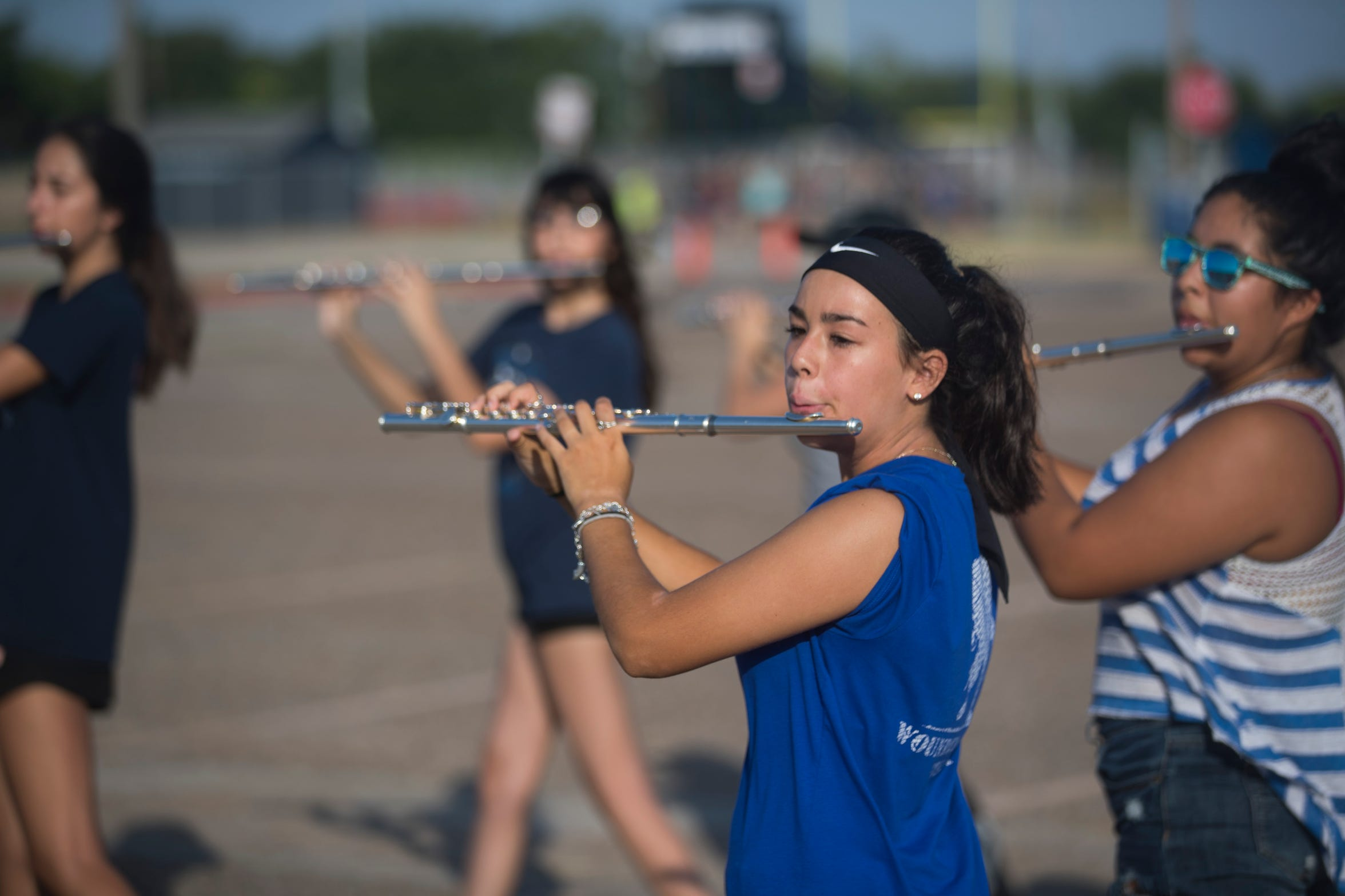 Carroll's Allyson Newton plays the flute during band practices in the parking lot of Carroll High School onMonday, July 30, 2018.