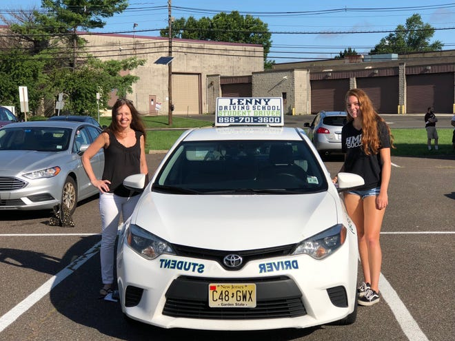 Christine Olimpio (left) of Haddonfield accompanies her daughter Maya, 17, to her road test at the Motor Vehicle Commission testing center on Hampton Road in Cherry Hill.