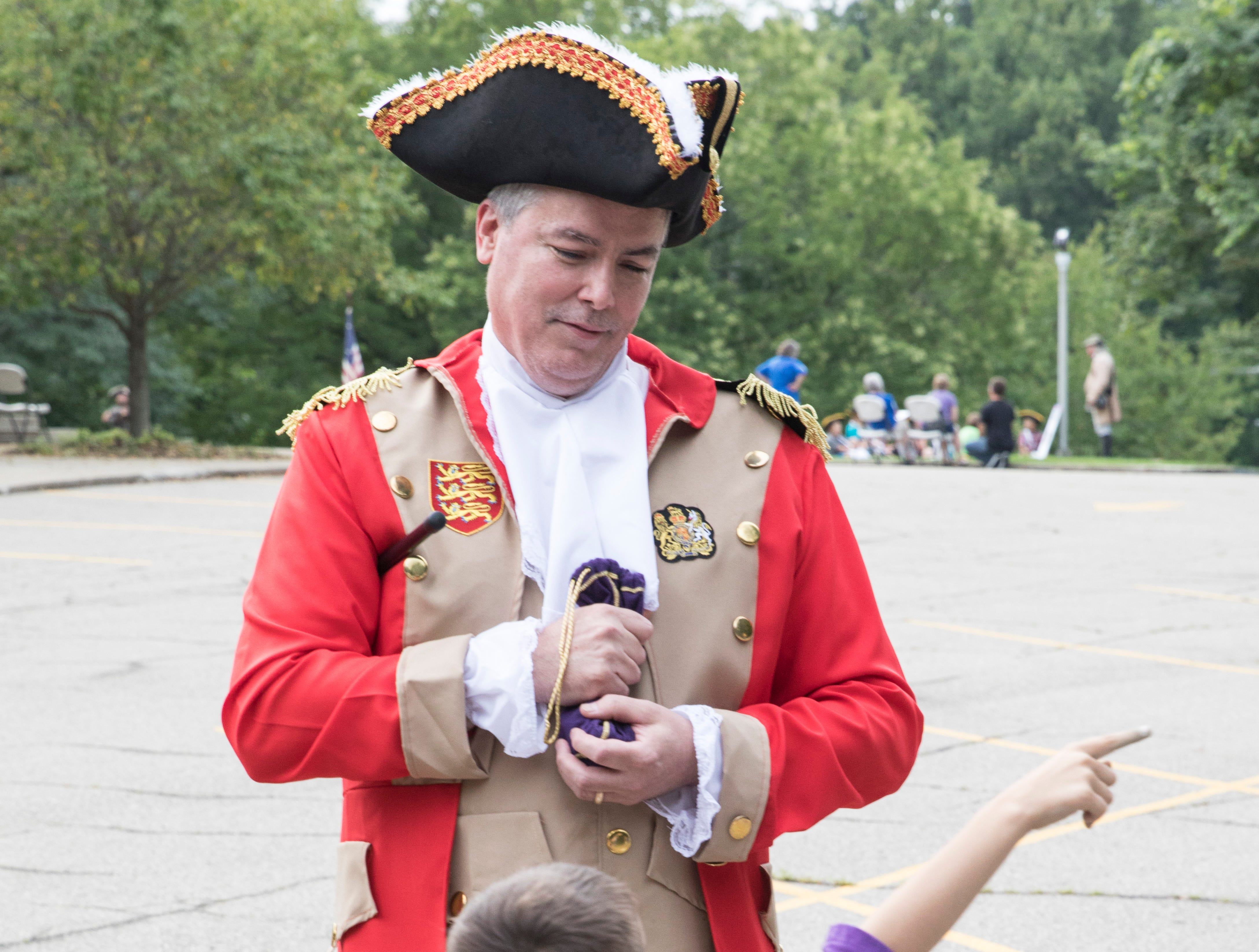 Mark Yanko tells King George III, re-enacted by Tim Hill, to return the people's money and go back to England.  Through re-enactments, stories, and games, Liberty Camp's mission was to educate children in a fun and memorable way.