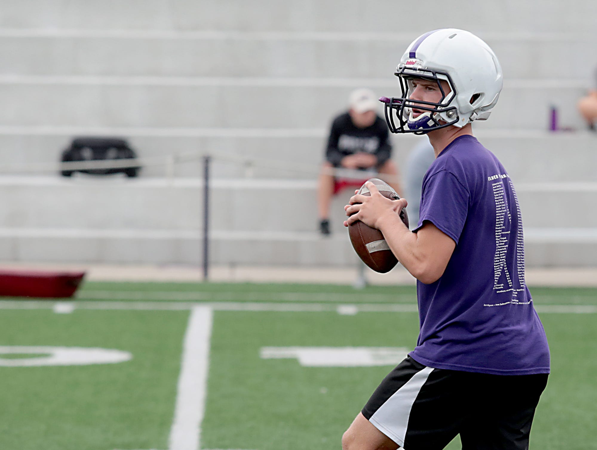 Elder quarterback Matthew Luebbe works out during practice Tuesday, July 31, 2018.