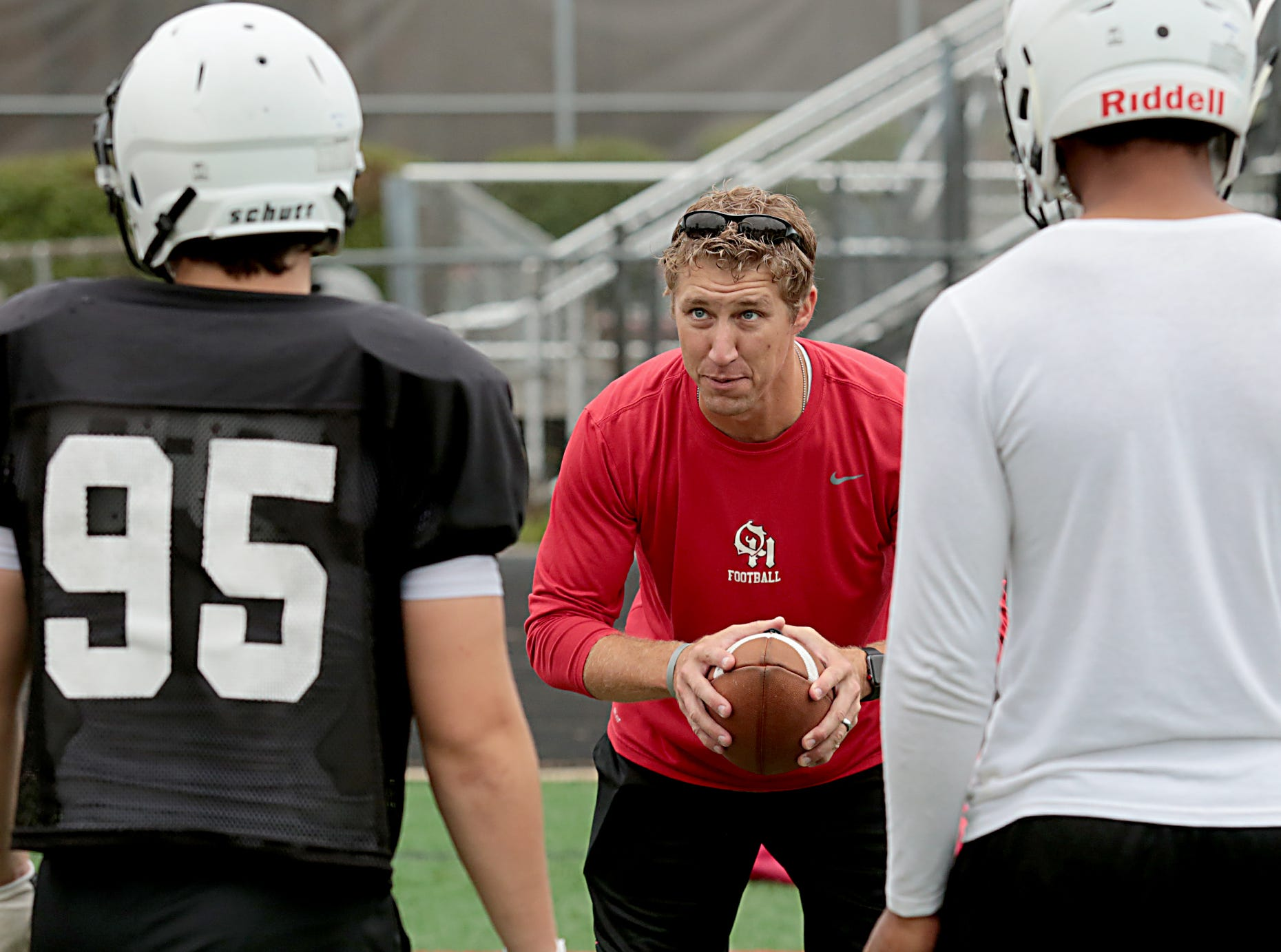 Oak Hills head football coach Kyle Prosser instructs his team Wednesday, Aug. 1, 2018.
