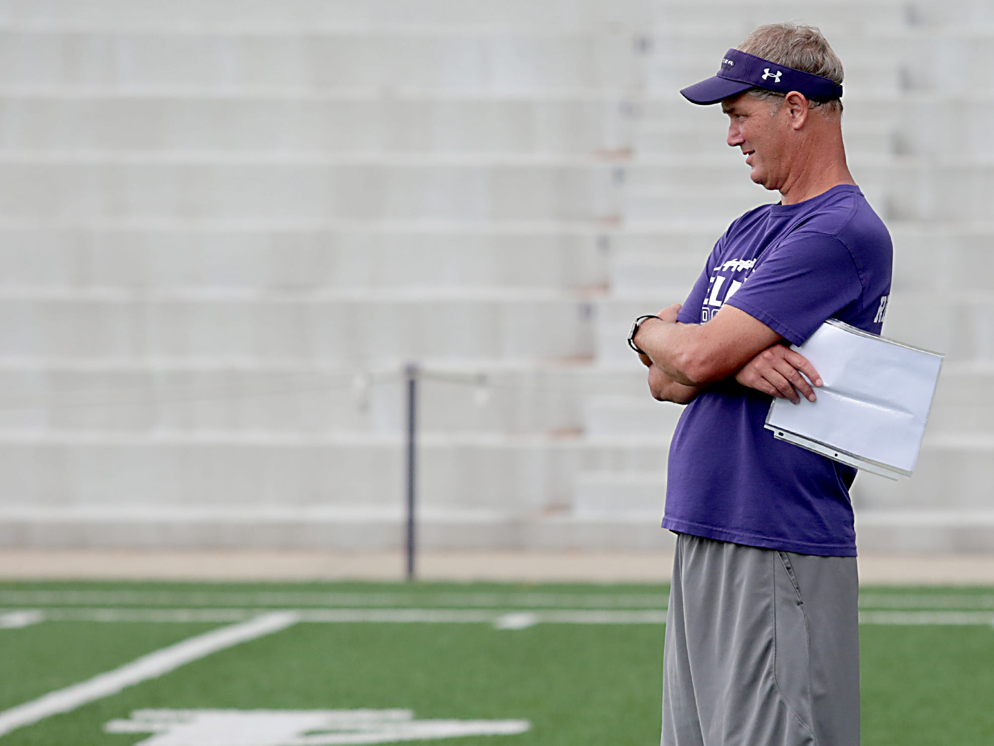 Elder High School head football coach Doug Ramsey watches practice at The Pit Tuesday, July 31, 2018.
