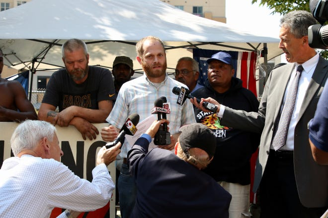 Josh Spring of the Homeless Coaltion speaks with members of the media during a press conference on Third Street.