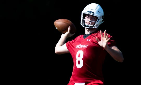 Cincinnati Bearcats quarterback Hayden Moore (8) throws a pass during University of Cincinnati Football practice at Higher Ground Convention Center in West Harrison, Ind., Friday, Aug. 3, 2018.