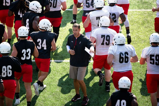 Cincinnati Bearcats head coach Luke Fickell talks to players during University of Cincinnati Football practice at Higher Ground Convention Center in West Harrison, Ind., Friday, Aug. 3, 2018.