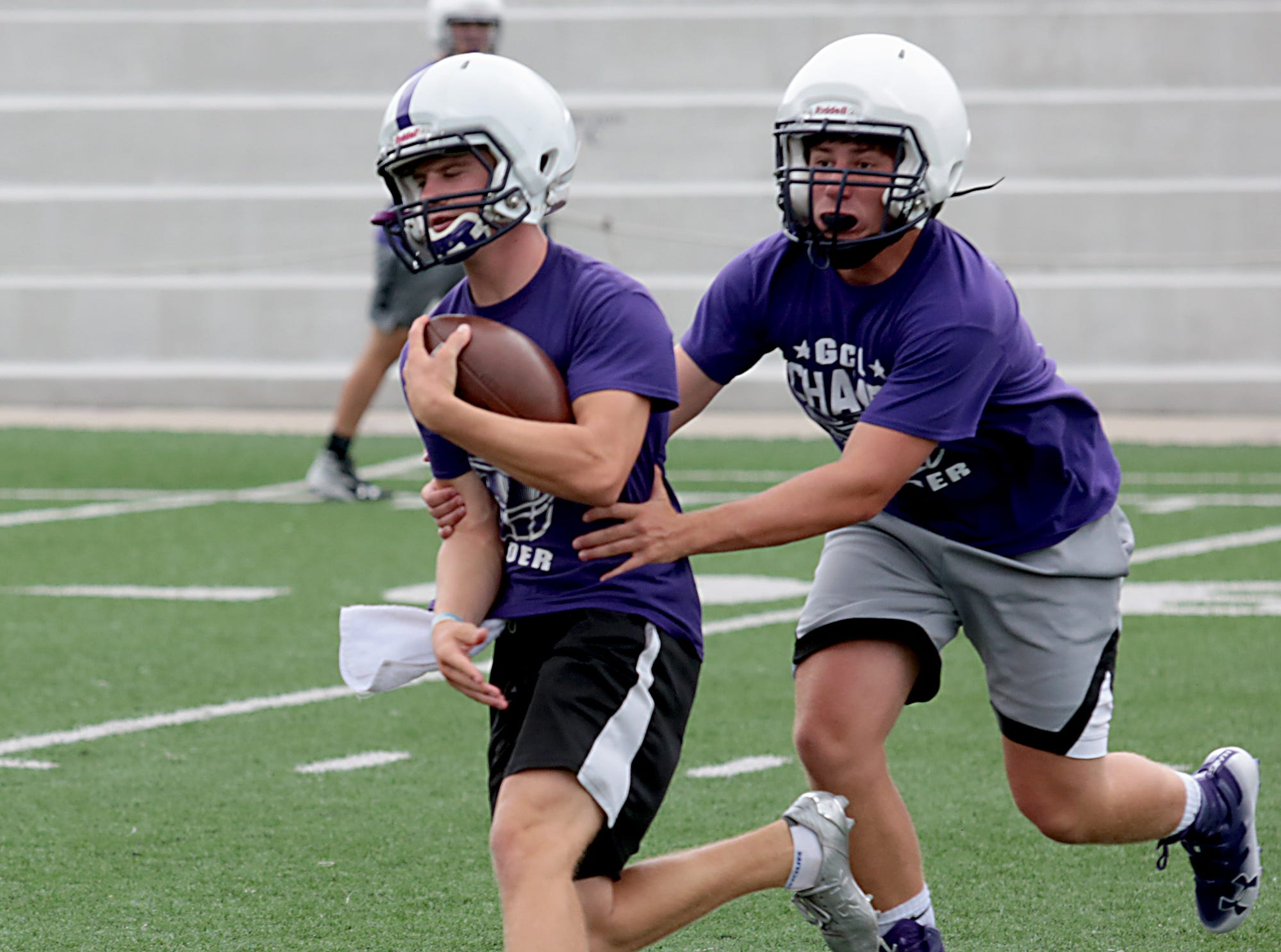 Matthew Luebbe tries to escape a teammate's tackle during practice Tuesday, July 31, 2018.