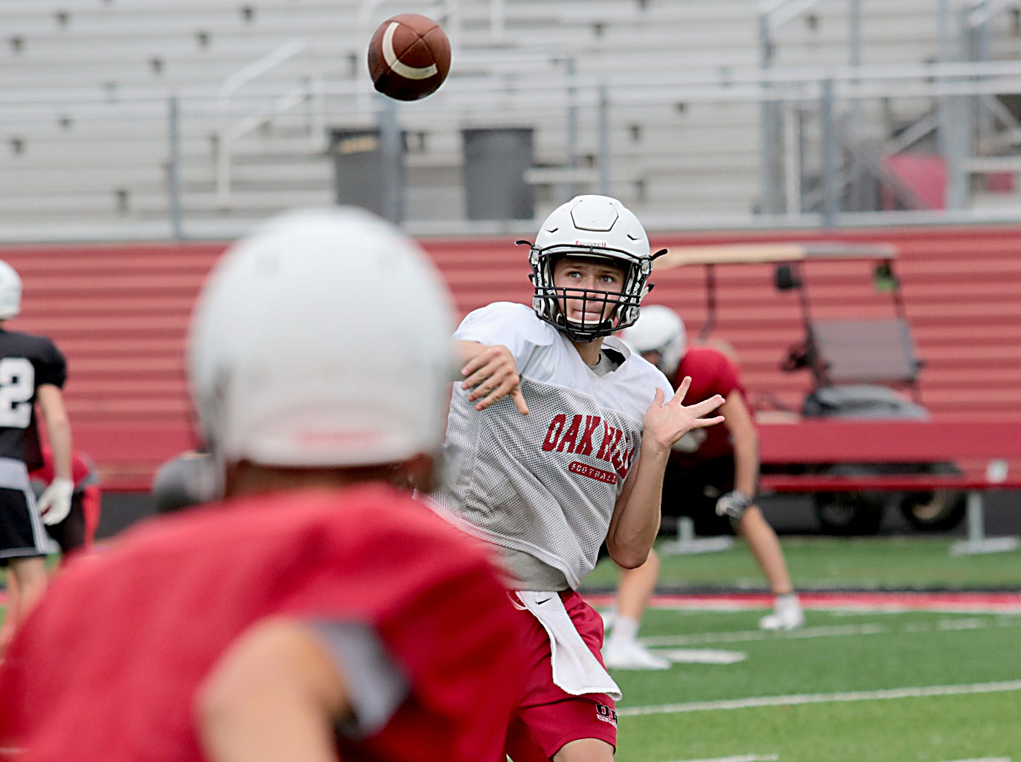 Oak Hills quarterback Ethan Myers throws a pass during practice Wednesday, Aug. 1, 2018.