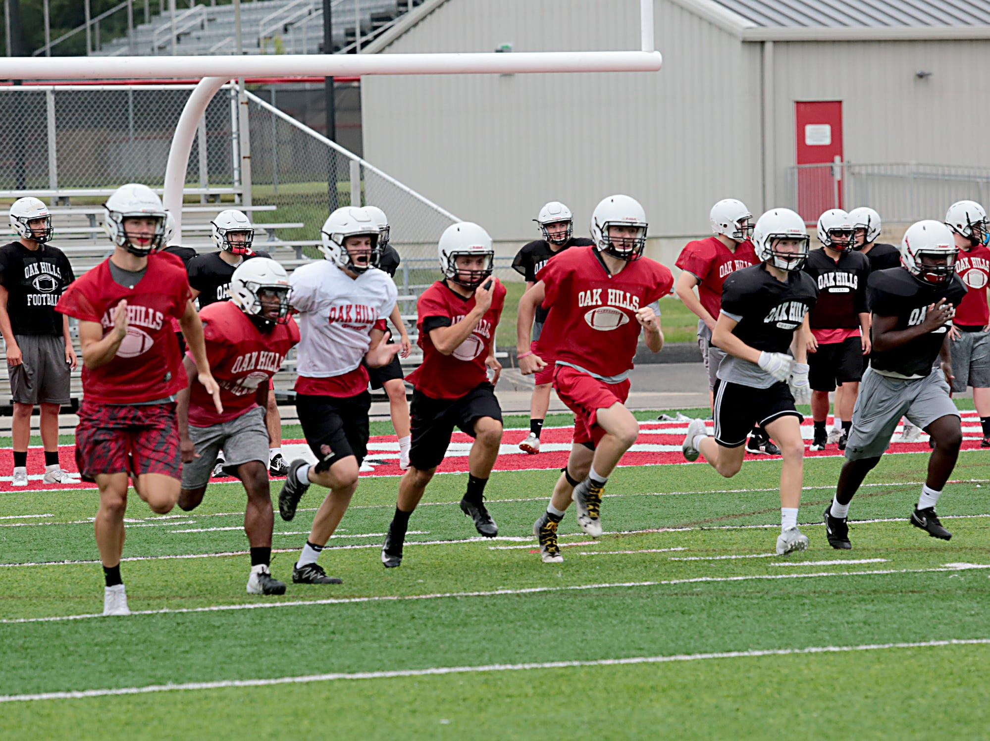 The Oak Hills football team practices Wednesday, Aug. 1, 2018.