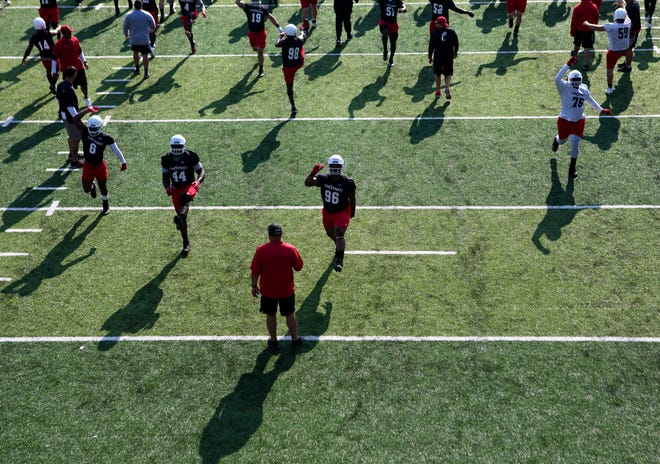 Cincinnati Bearcats defensive lineman Cortez Broughton (96) stretches with the rest of the team during University of Cincinnati Football practice at Higher Ground Convention Center in West Harrison, Ind., Friday, Aug. 3, 2018.