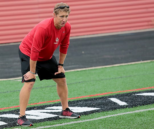 Oak Hills football head coach Kyle Prosser watches his team during practice Wednesday, Aug. 1, 2018. E.L. Hubbard for the Enquirer
