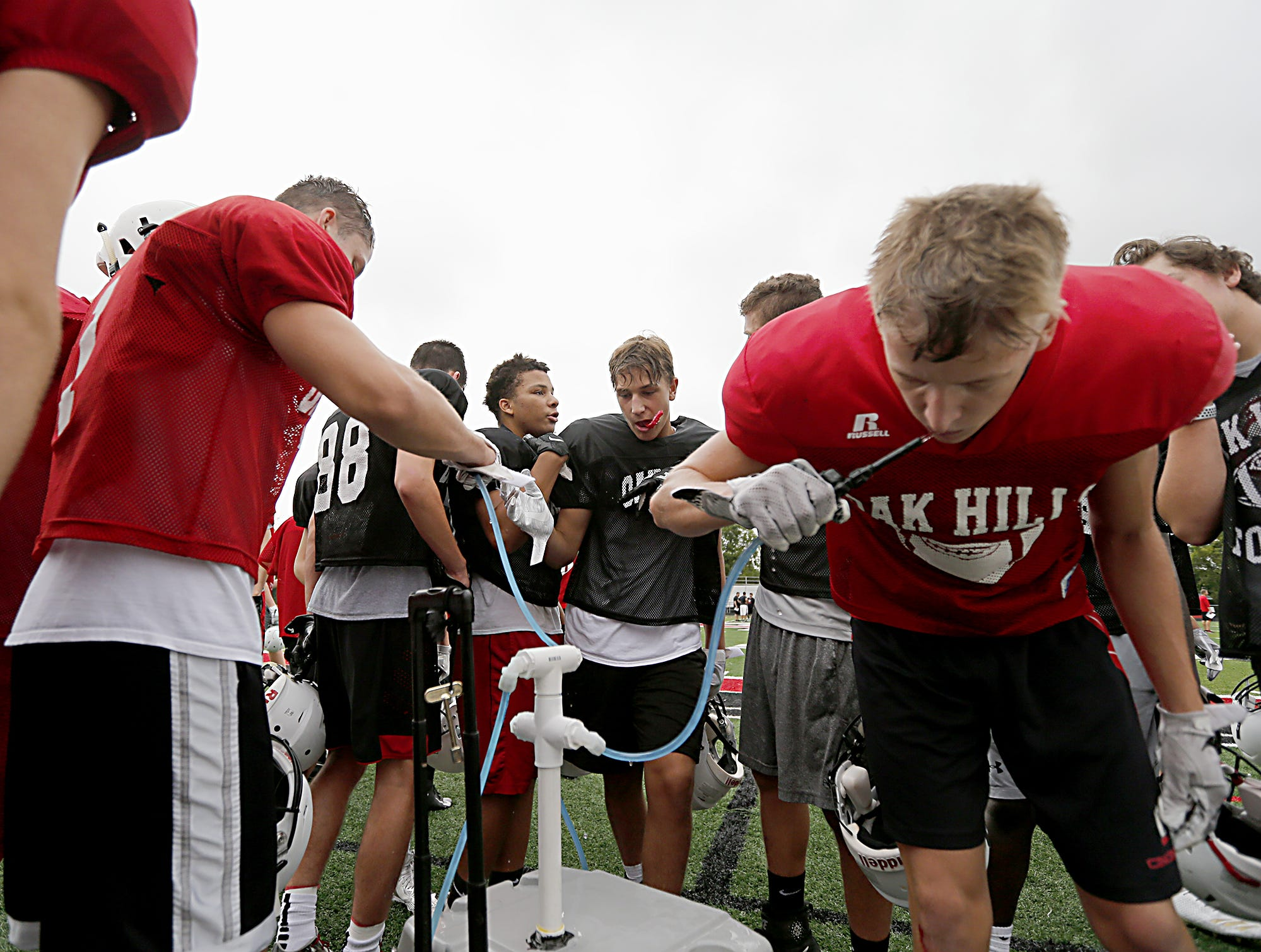 Players get a water break during football practice at Oak Hills Wednesday, Aug. 1, 2018. E.L. Hubbard for the Enquirer
