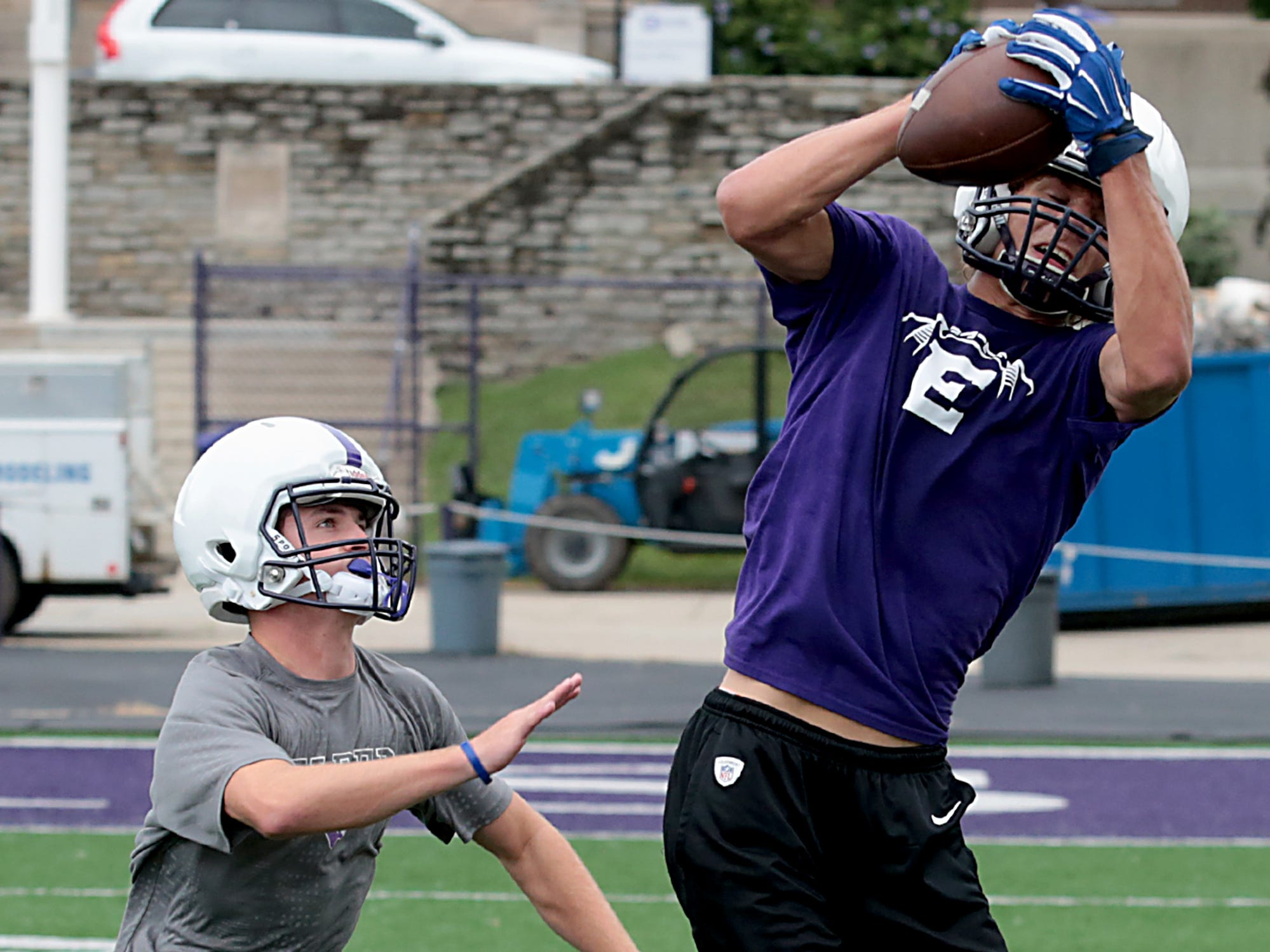Elder defensive back Ben Deters watches tight end Joe Royer pull down a pass during practice Tuesday, July 31, 2018.