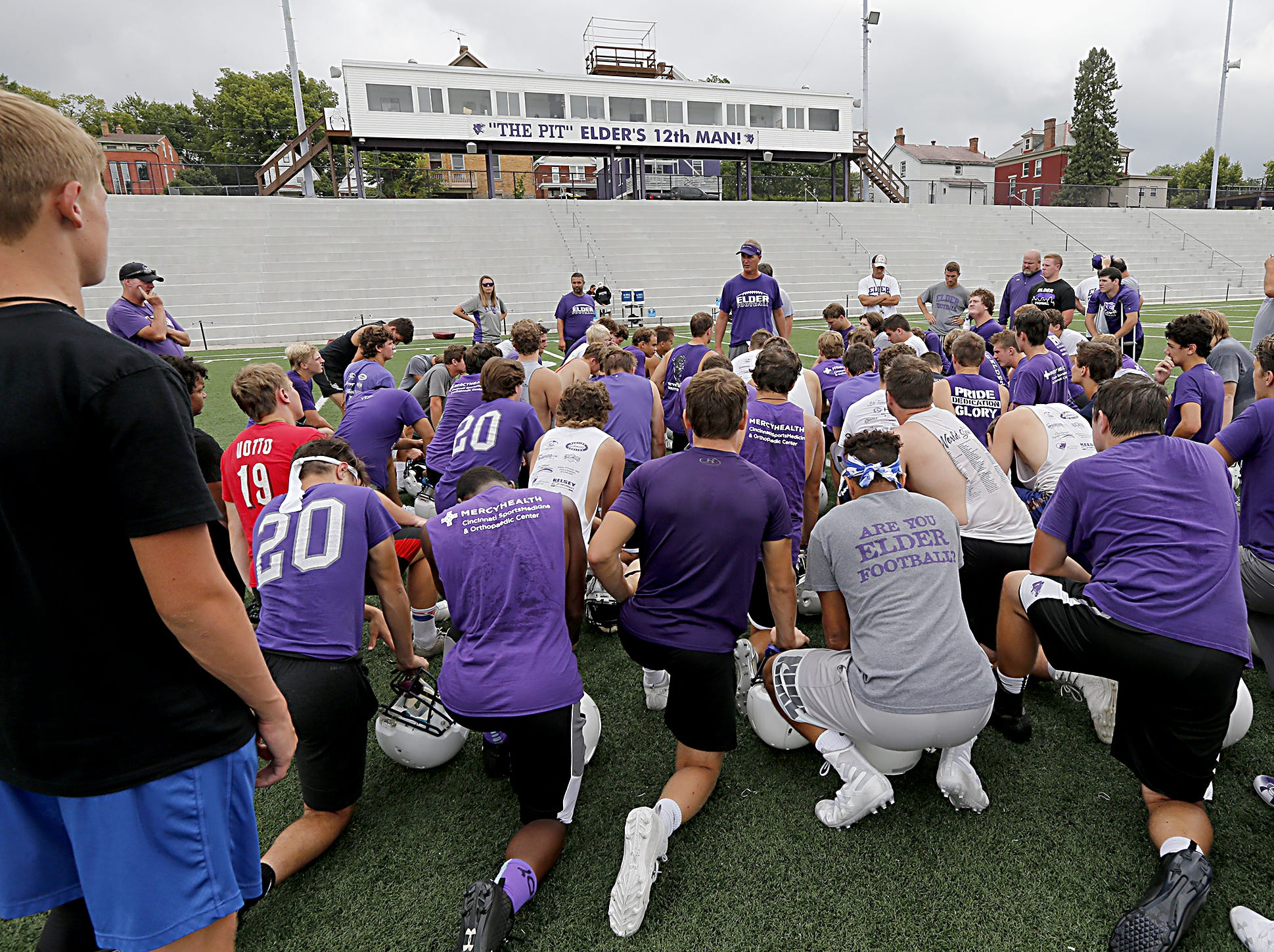 Elder head coach Doug Ramsey speaks to his team during practice Tuesday, July 31, 2018.